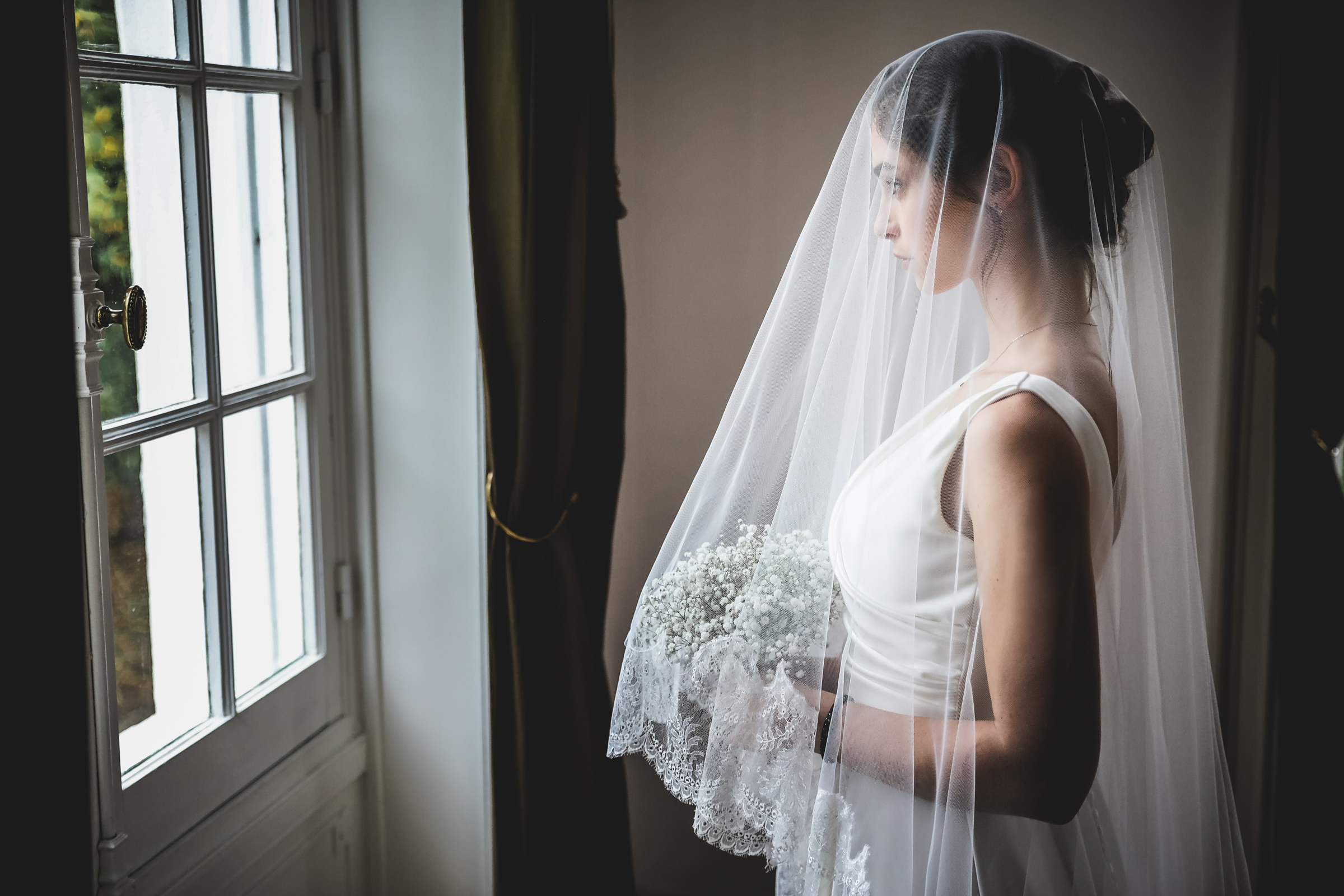 contemplative-shot-of-veiled-bride-julien-laurent-georges