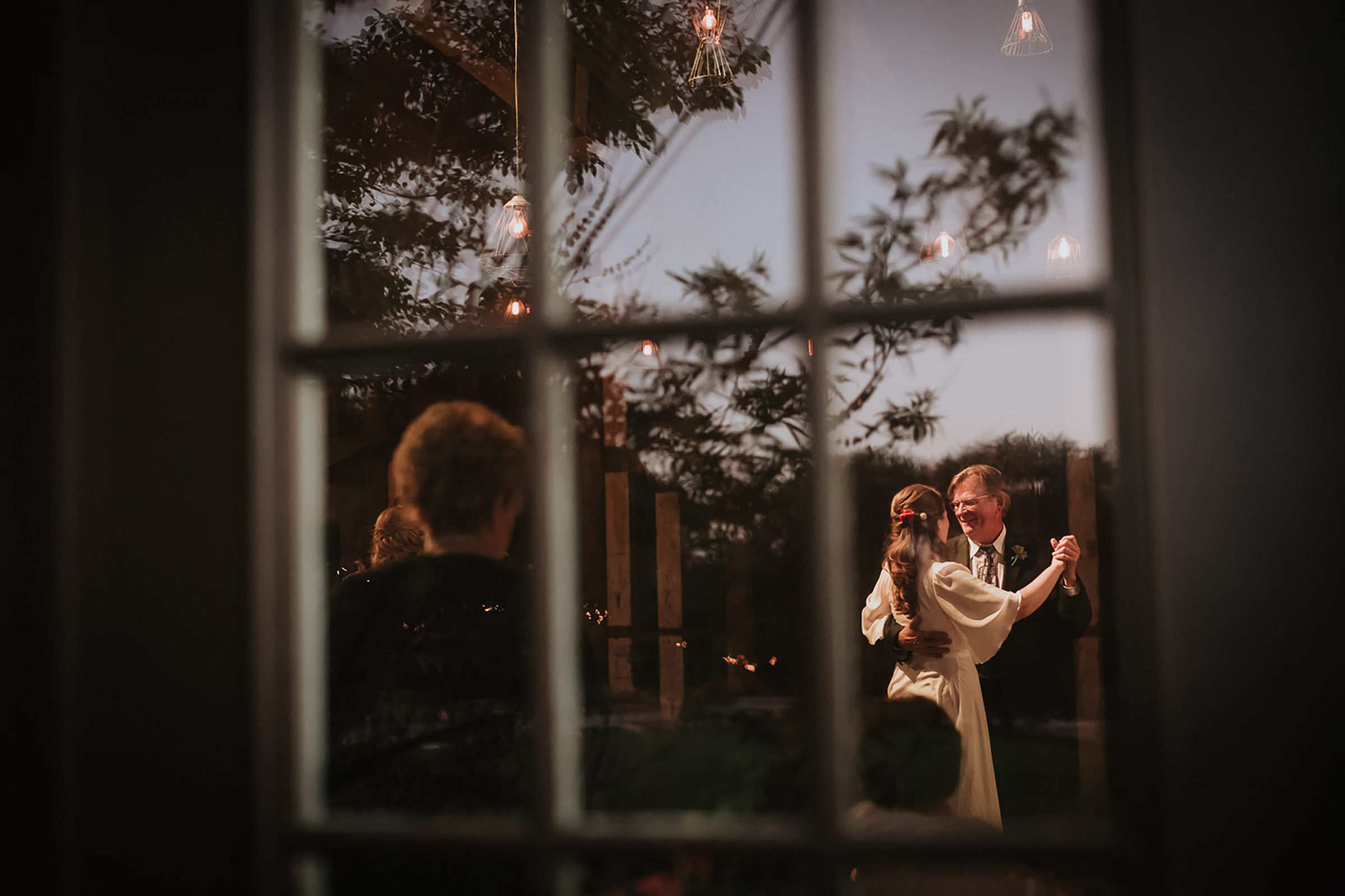 couple-dancing-under-the-twilights-creek-haus-dripping-springs-texas-by-philip-thomas-photography