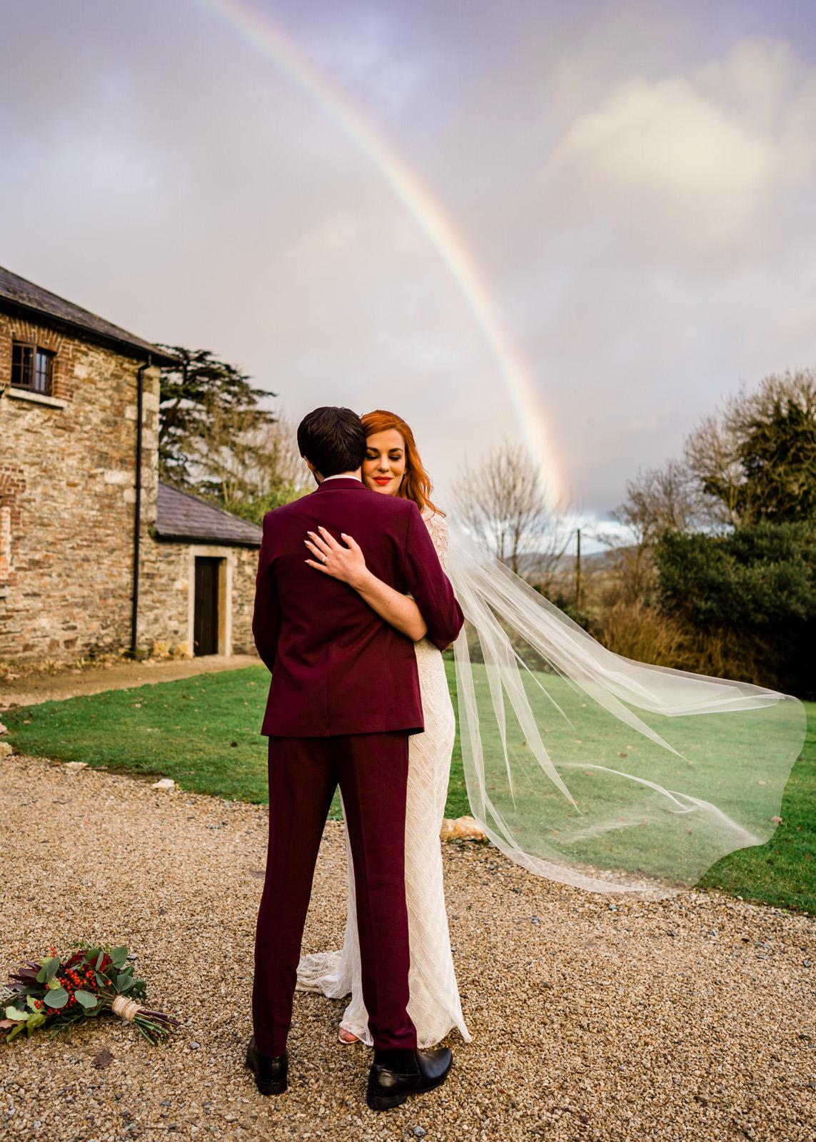 couple-hug-under-rainbow-the-portrait-rooms