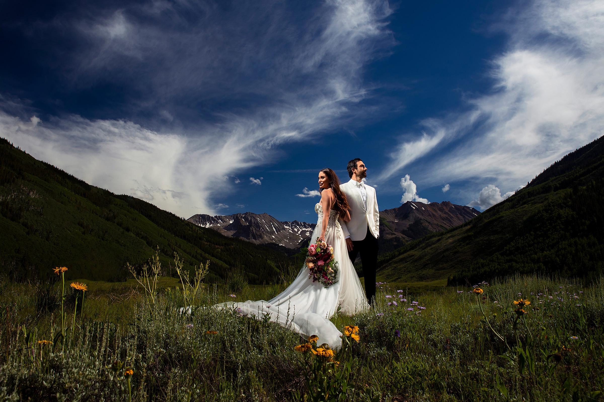 Just married couple in wildflower field, Aspen Colorado - photo by J. La Plante Photo