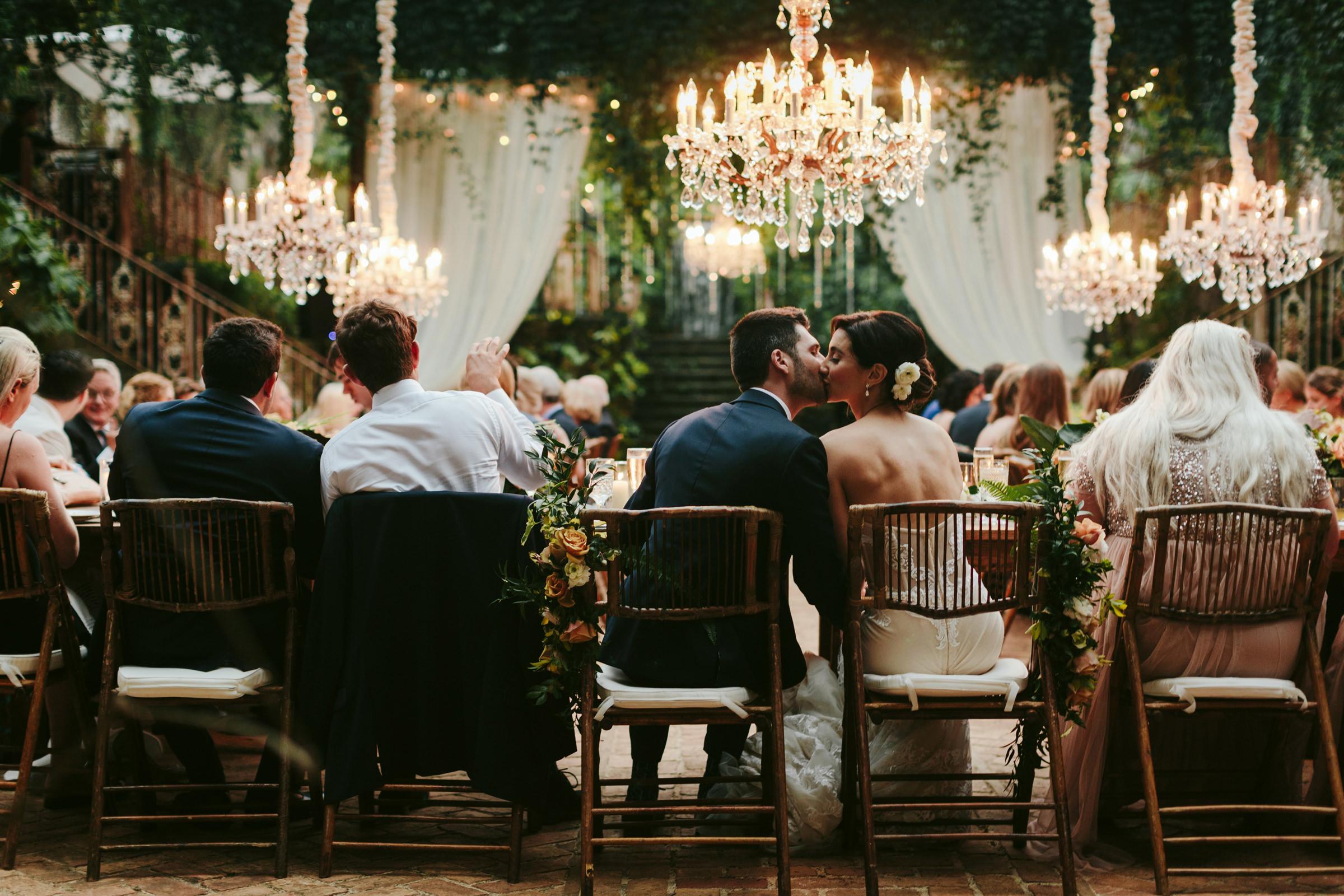 Couple kisses at Haiku Mill wedding reception - photo by Melia Lucida Photography
