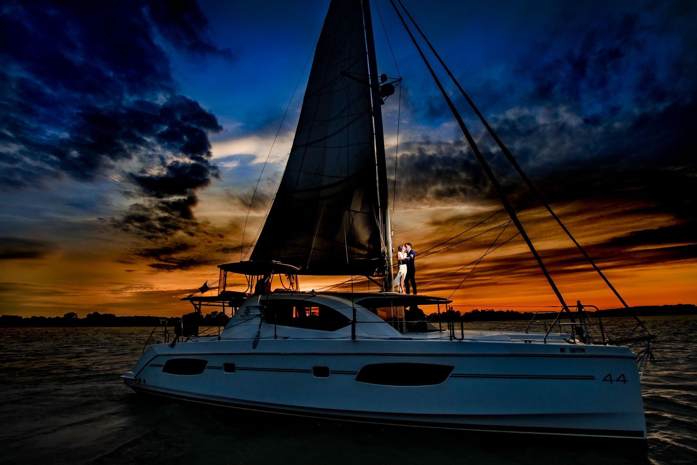 couple-on-catamaran-at-sunset-jos-tree