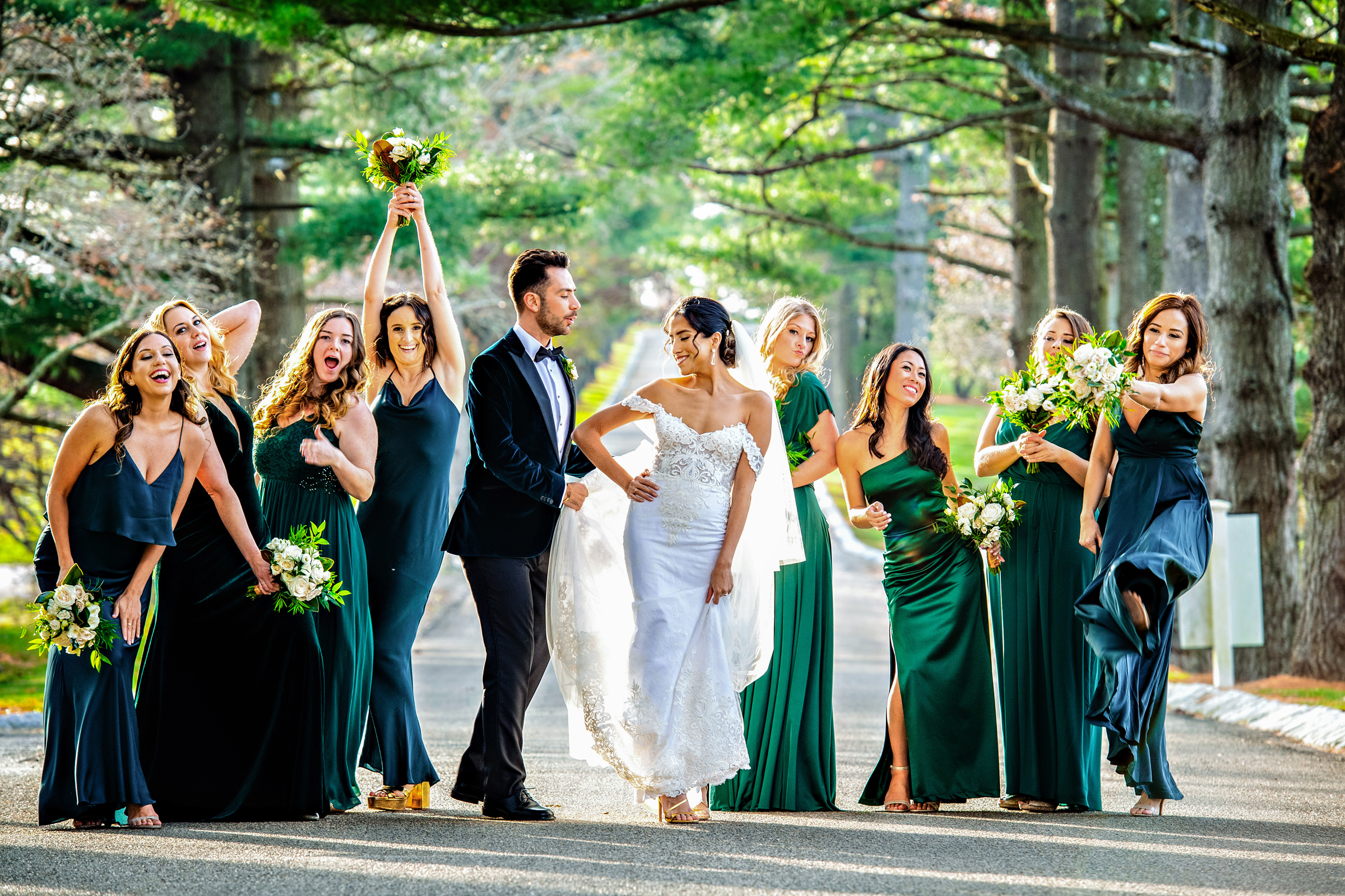 Bridesmaids in navy and emerald green spaghetti strap dresses - photographed by Jeff Tisman - New York