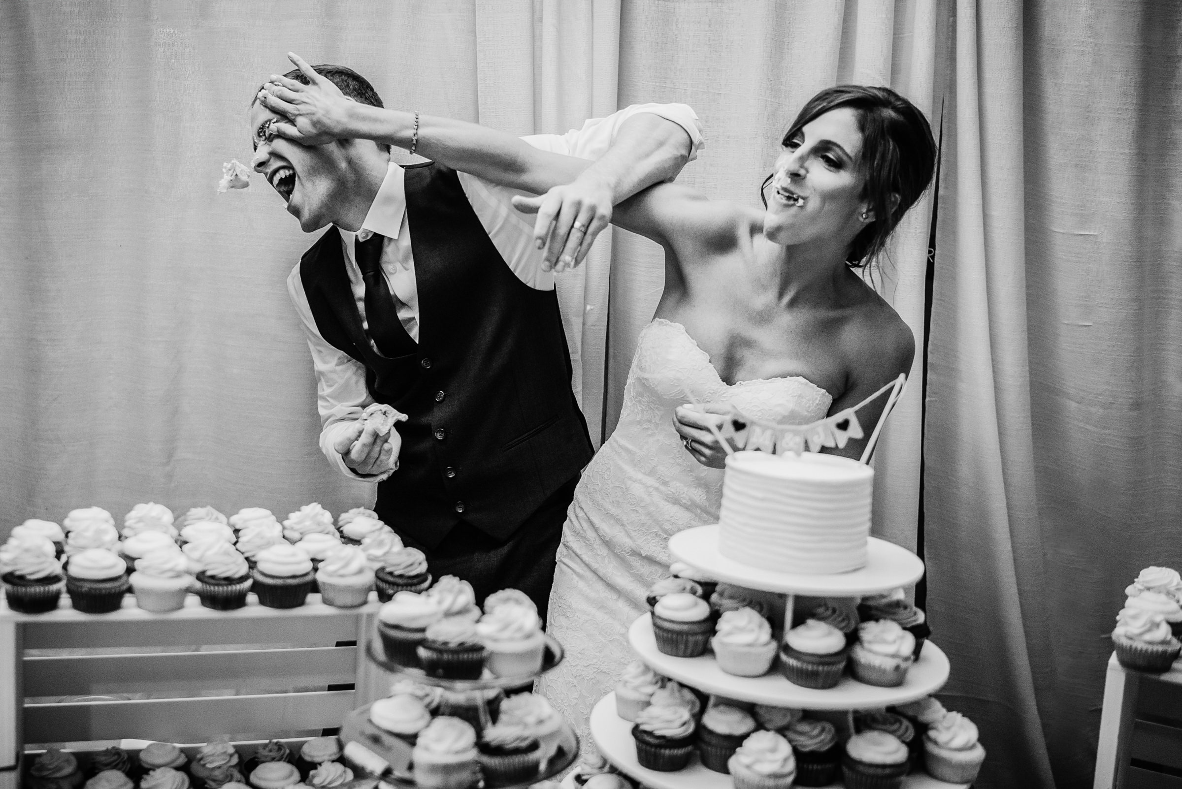 Bride and groom smash cupcakes in each other's faces - photo by Sasha Reiko - Seattle