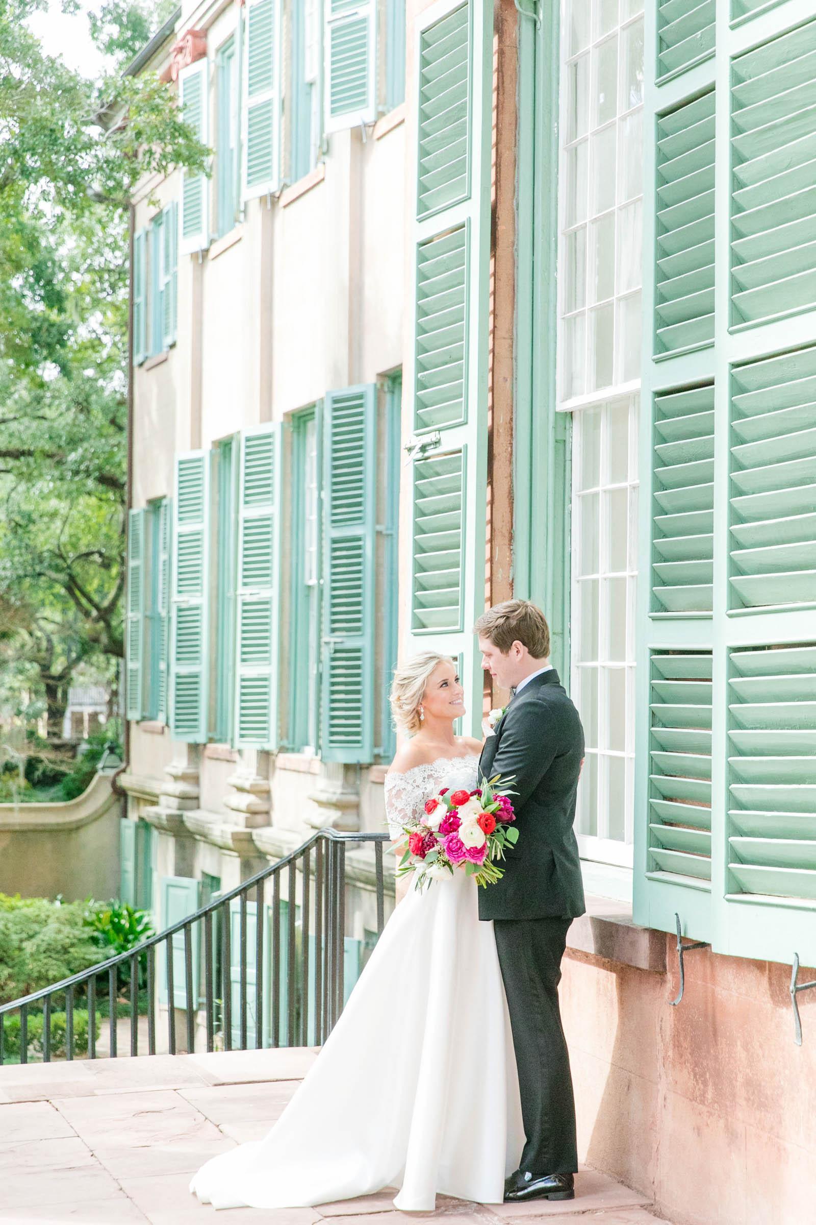 couple-portrait-against-aqua-shutters-dana-cubbage-weddings
