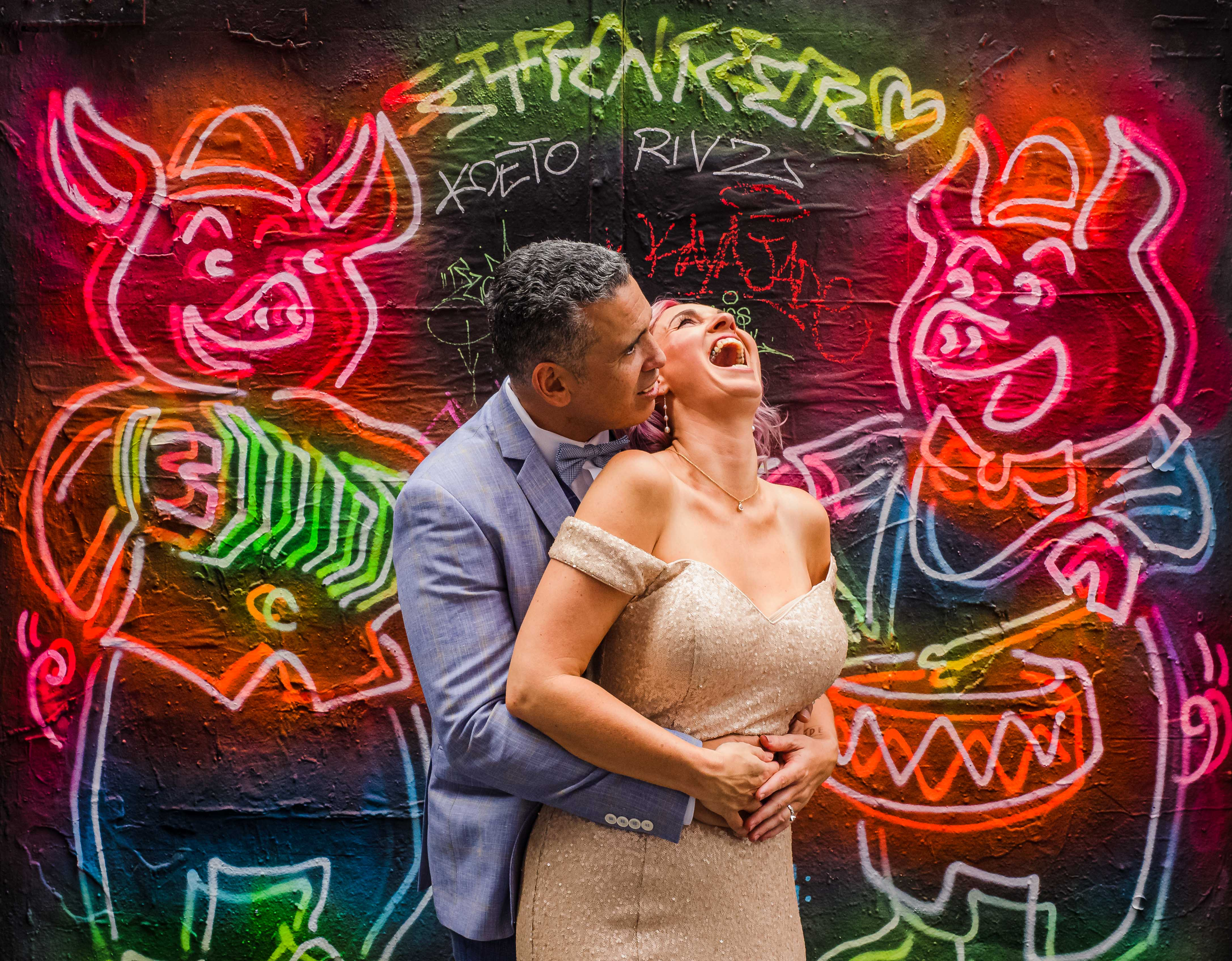 couple-portrait-against-neon-wall-hosier-lane-melbourne-australia-sean-reefman-photography