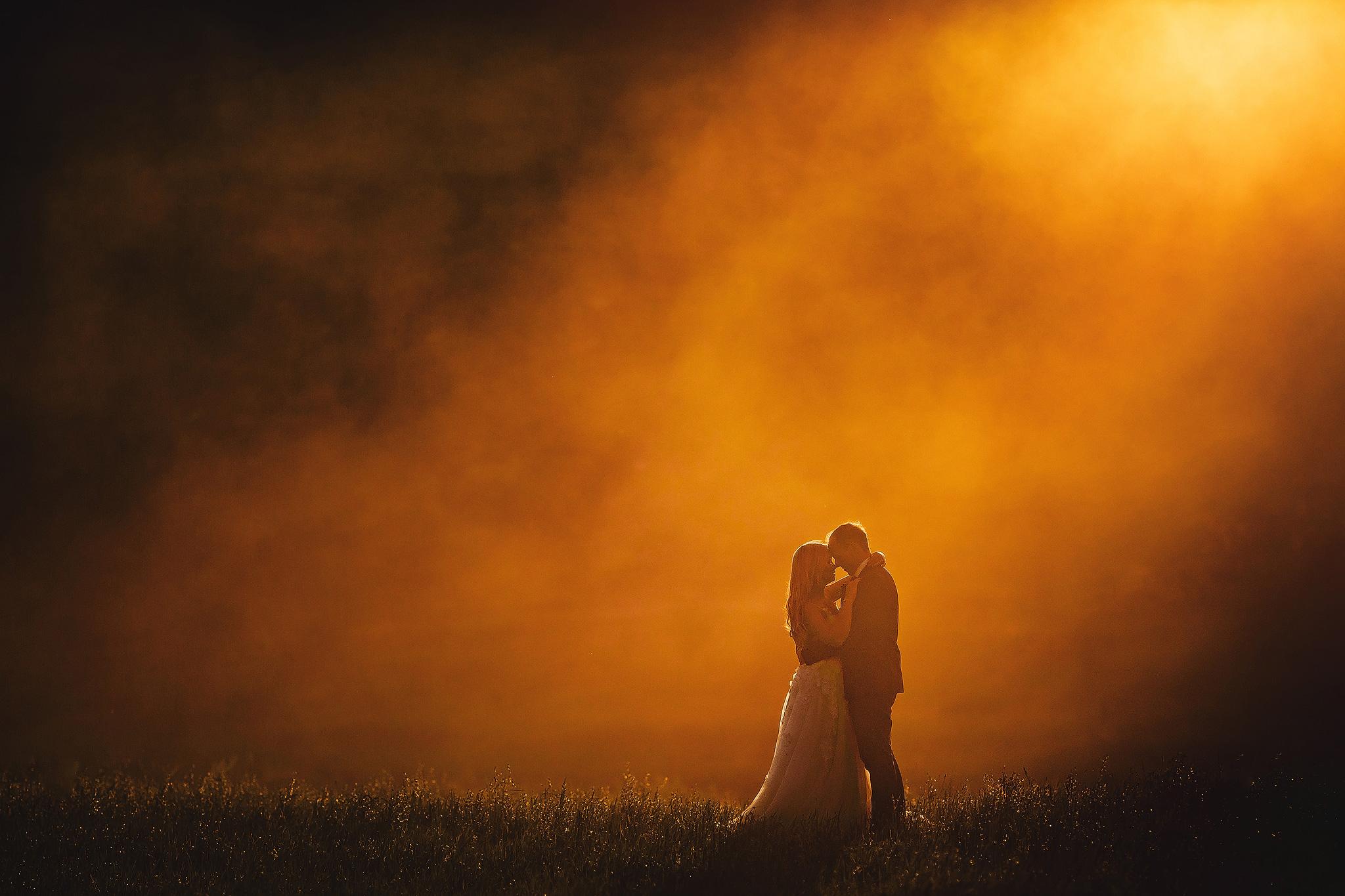 couple-portrait-against-orange-haze-ruan-redelinghuys-photography