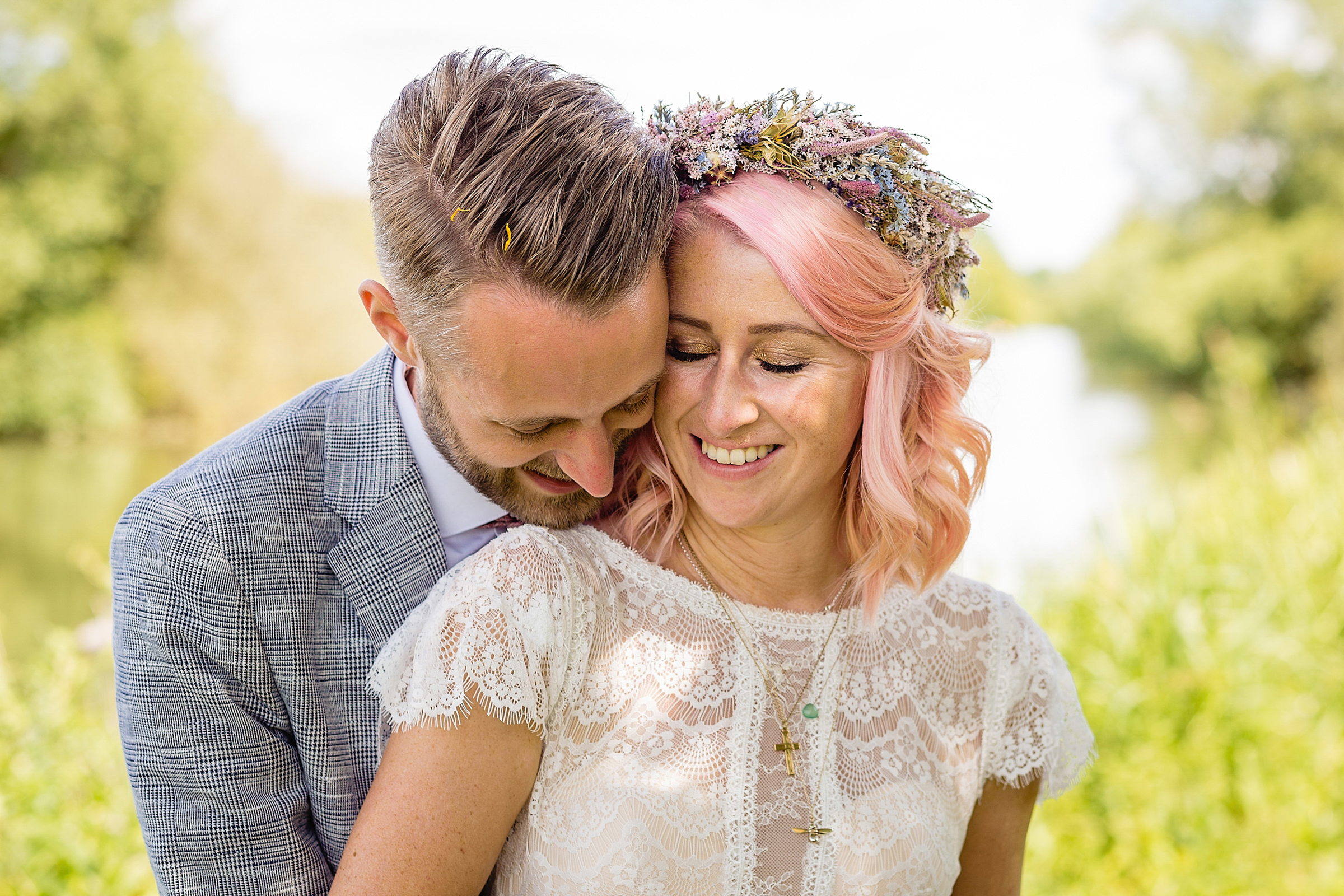 Bride in lace dress with pink hair and floral wreath - photo by Emma plus Rich - UK
