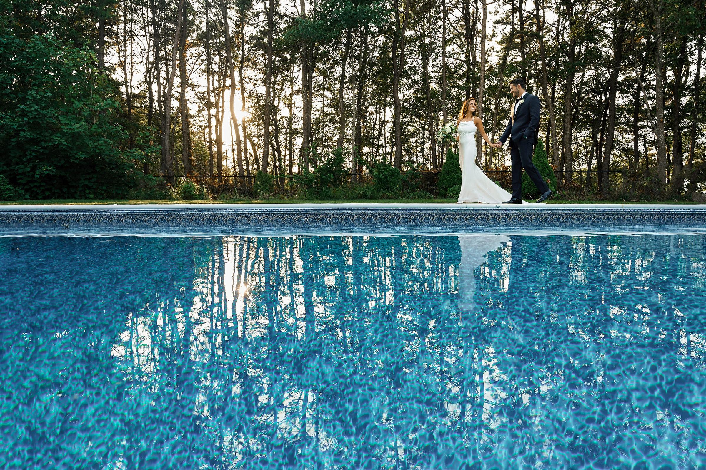 Couple walking by pool by Alex Gordias - Cape Cod