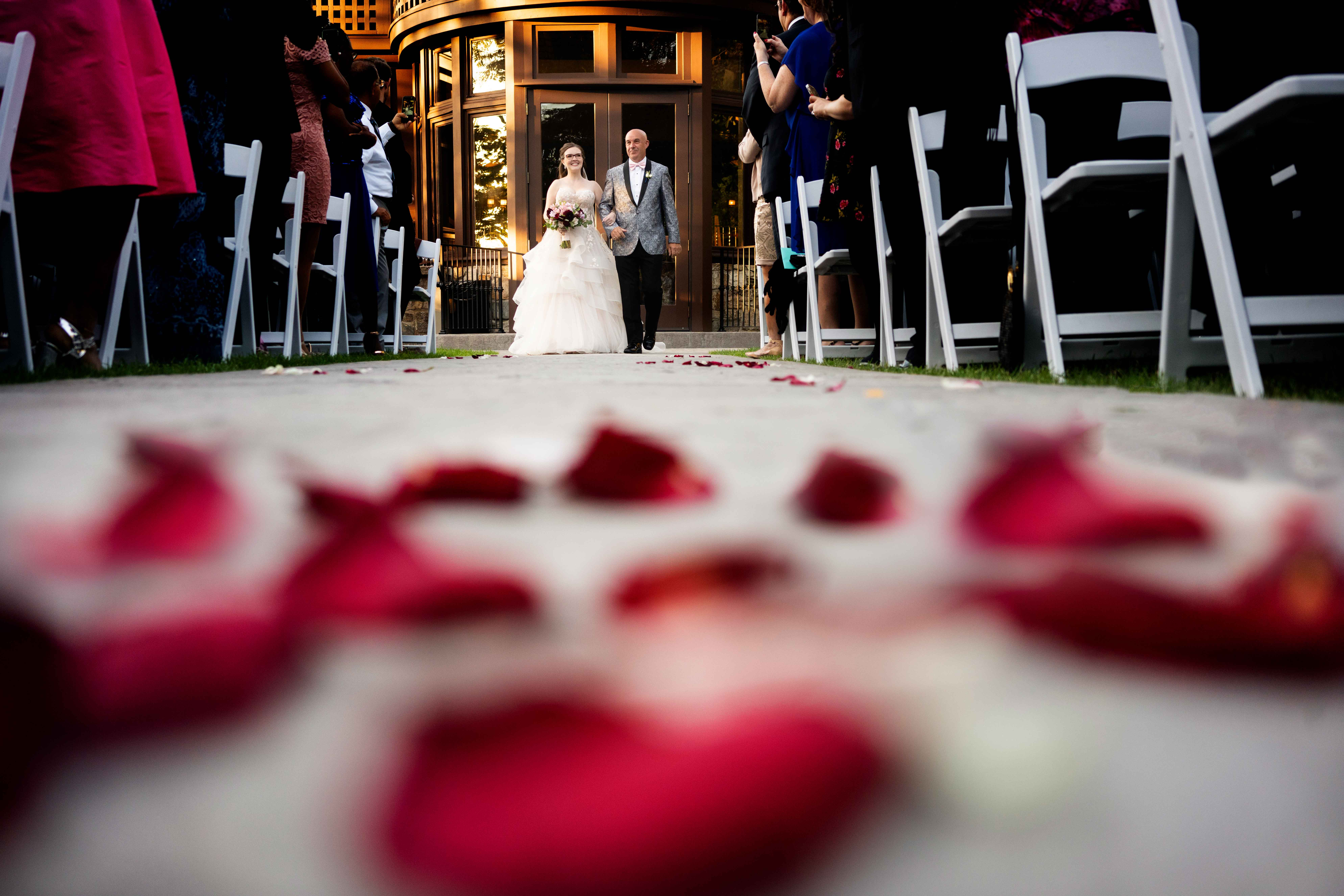 creative-angle-on-bride-walking-down-aisle-with-father-md-photo-films