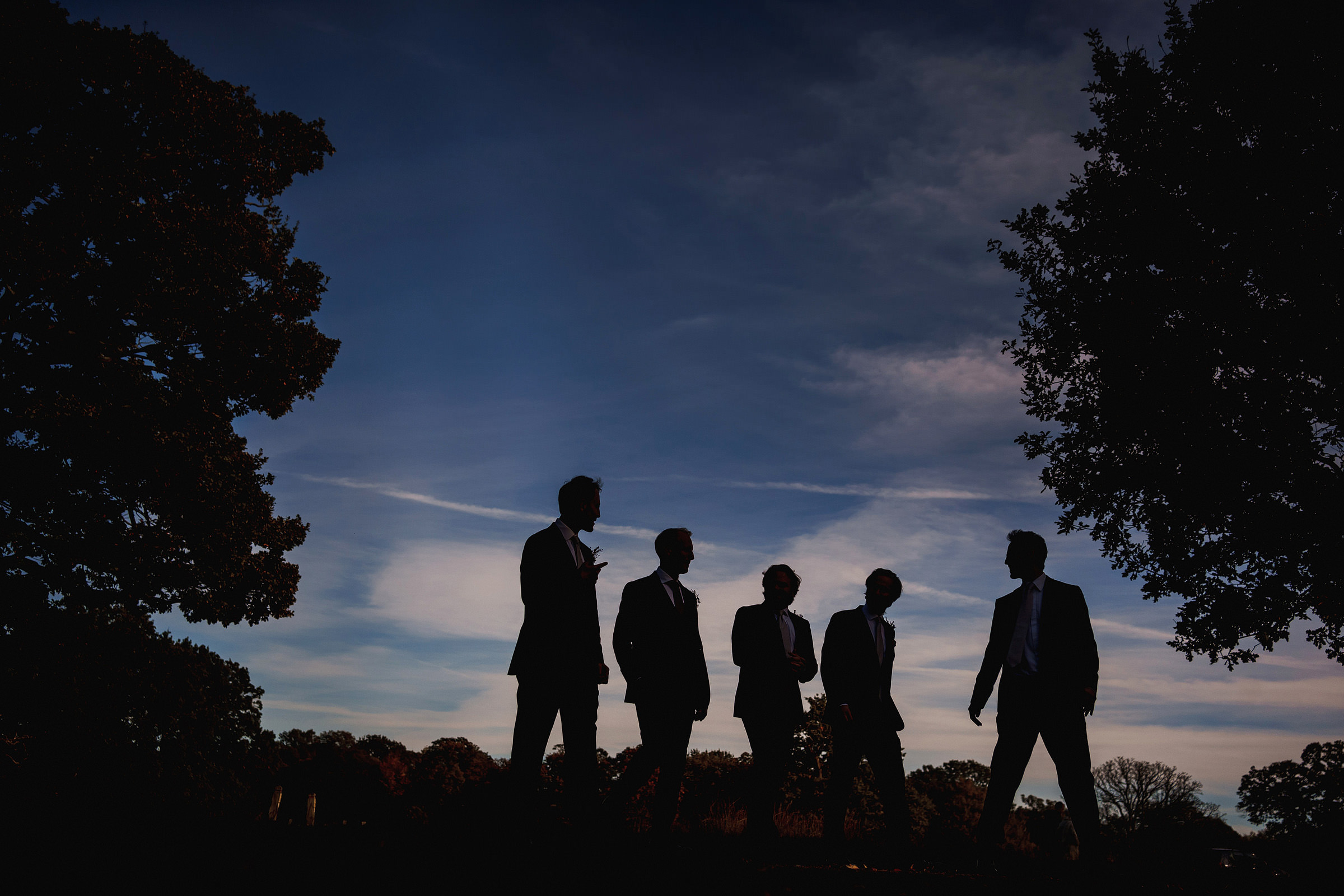 Creative group portrait of groomsmen by f5 best London wedding photographer