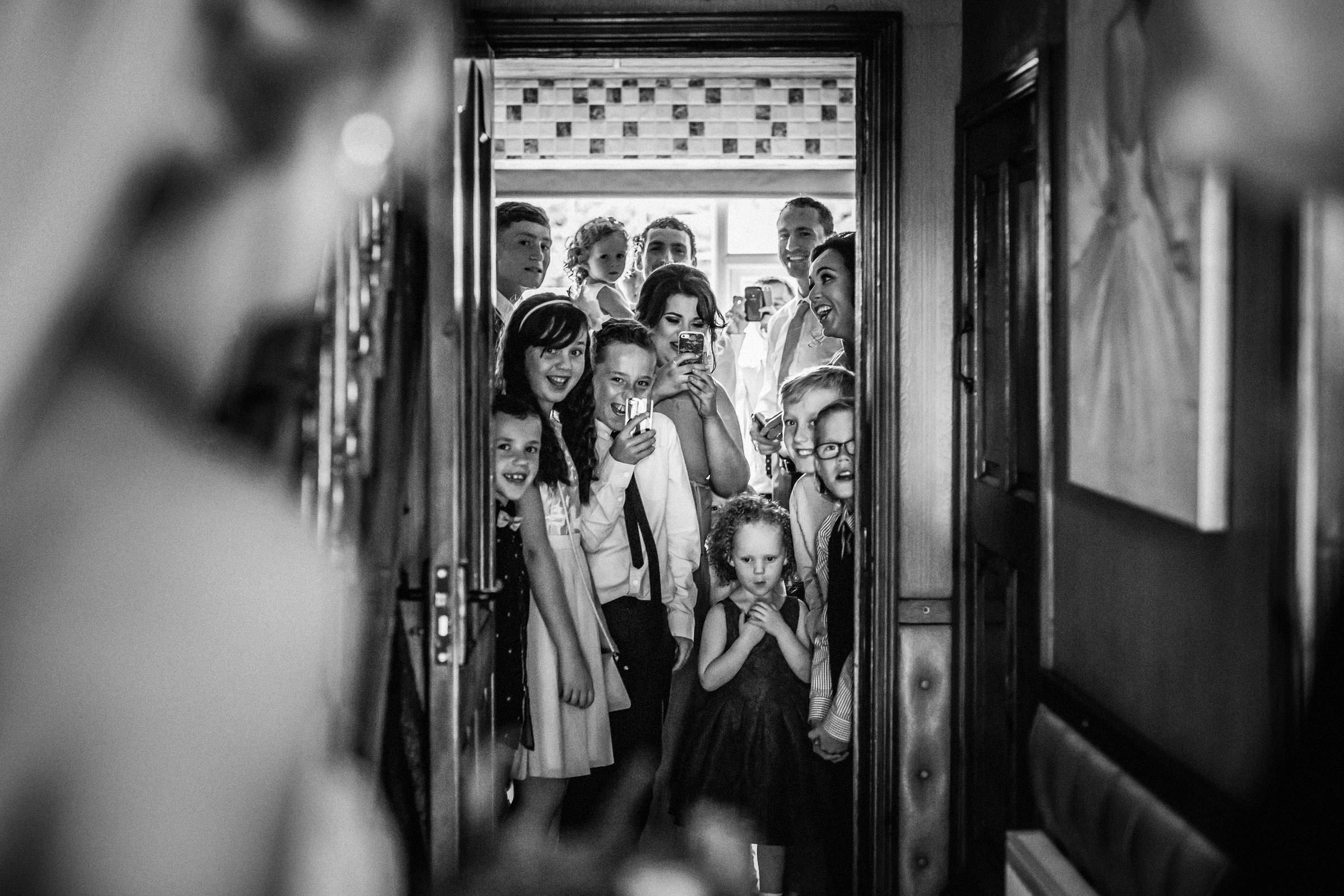 crowd-at-doorway-to-win-first-glimpse-of-bride-lima-conlon-photography