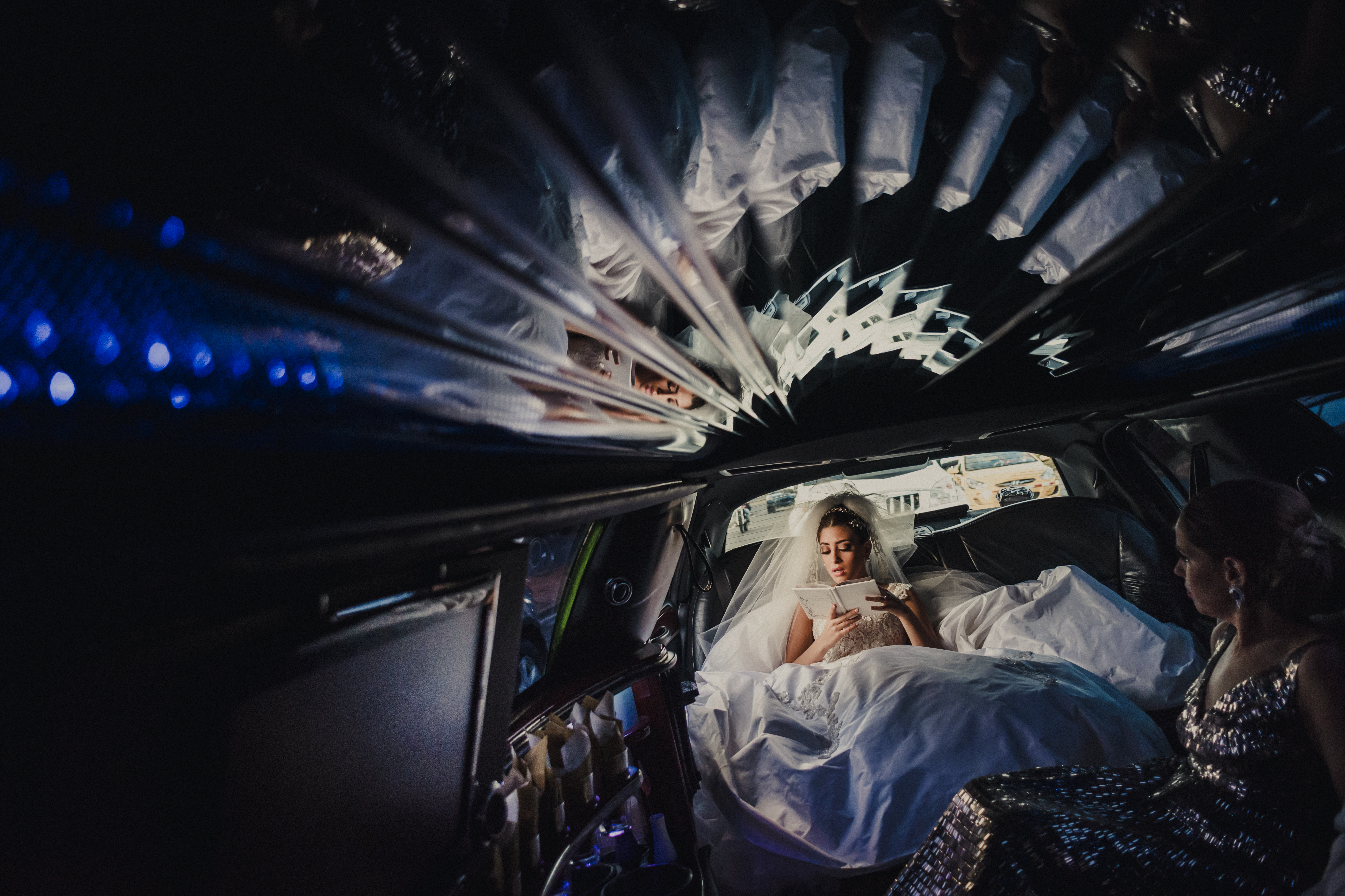 Bride reflected in mirrored ceiling of limousine - photo by El Marco Rojo - Spain