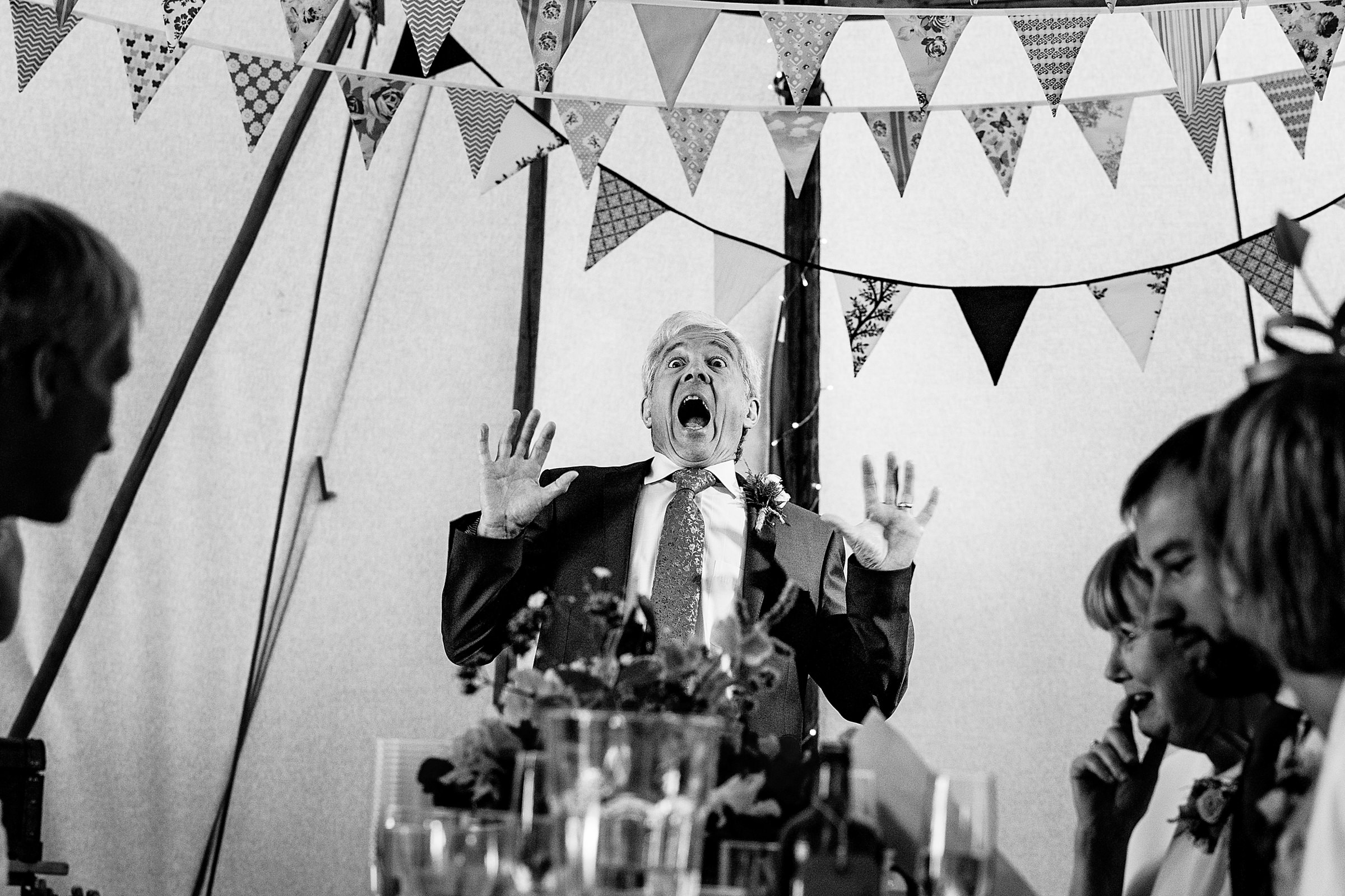 Father makes hilarious face during toast - photo by Emma and Rich - England
