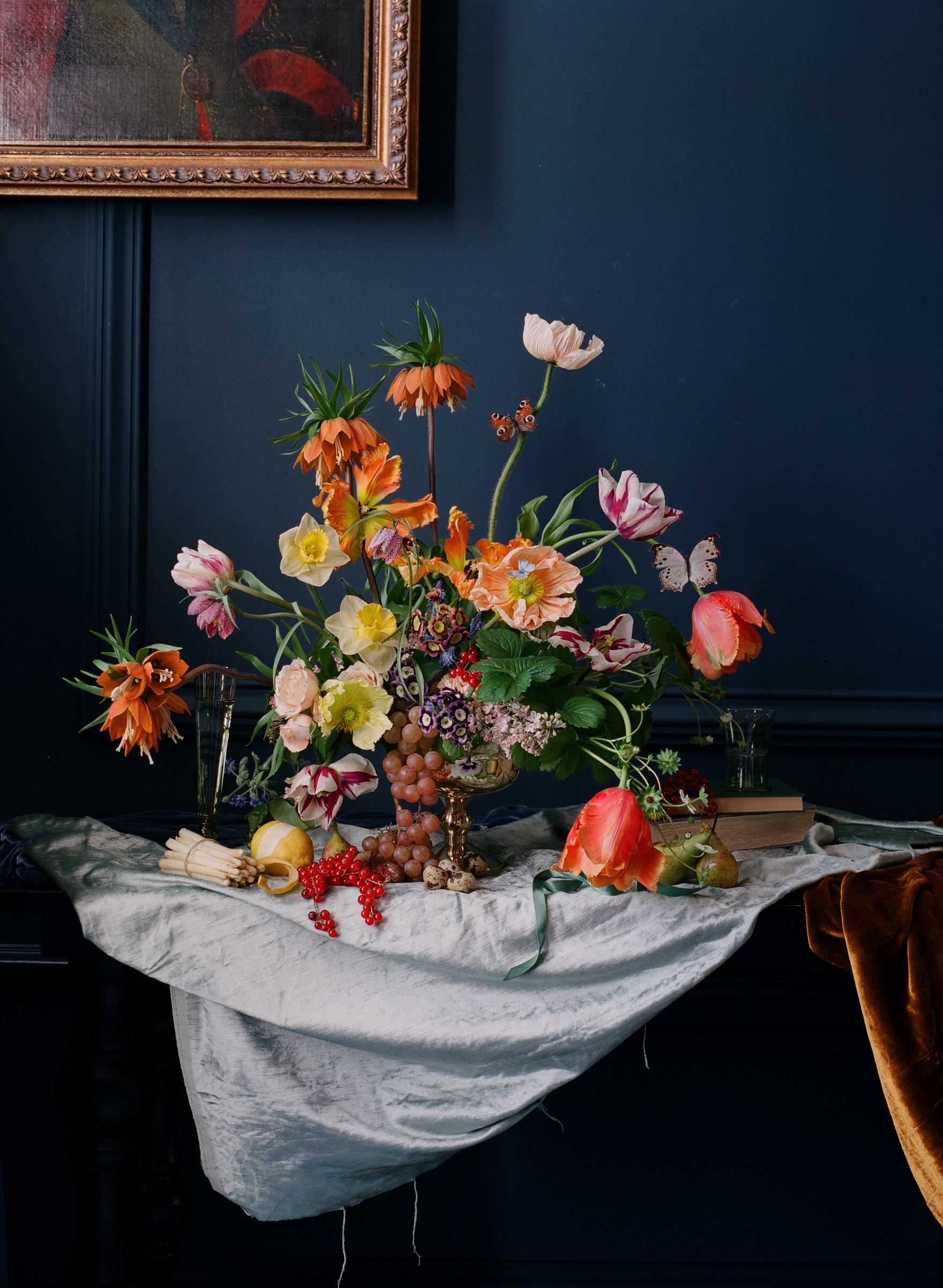Floral centerpieces with tulips, poppies, and fritallari photographed by Corbin Gurkin - South Carolina