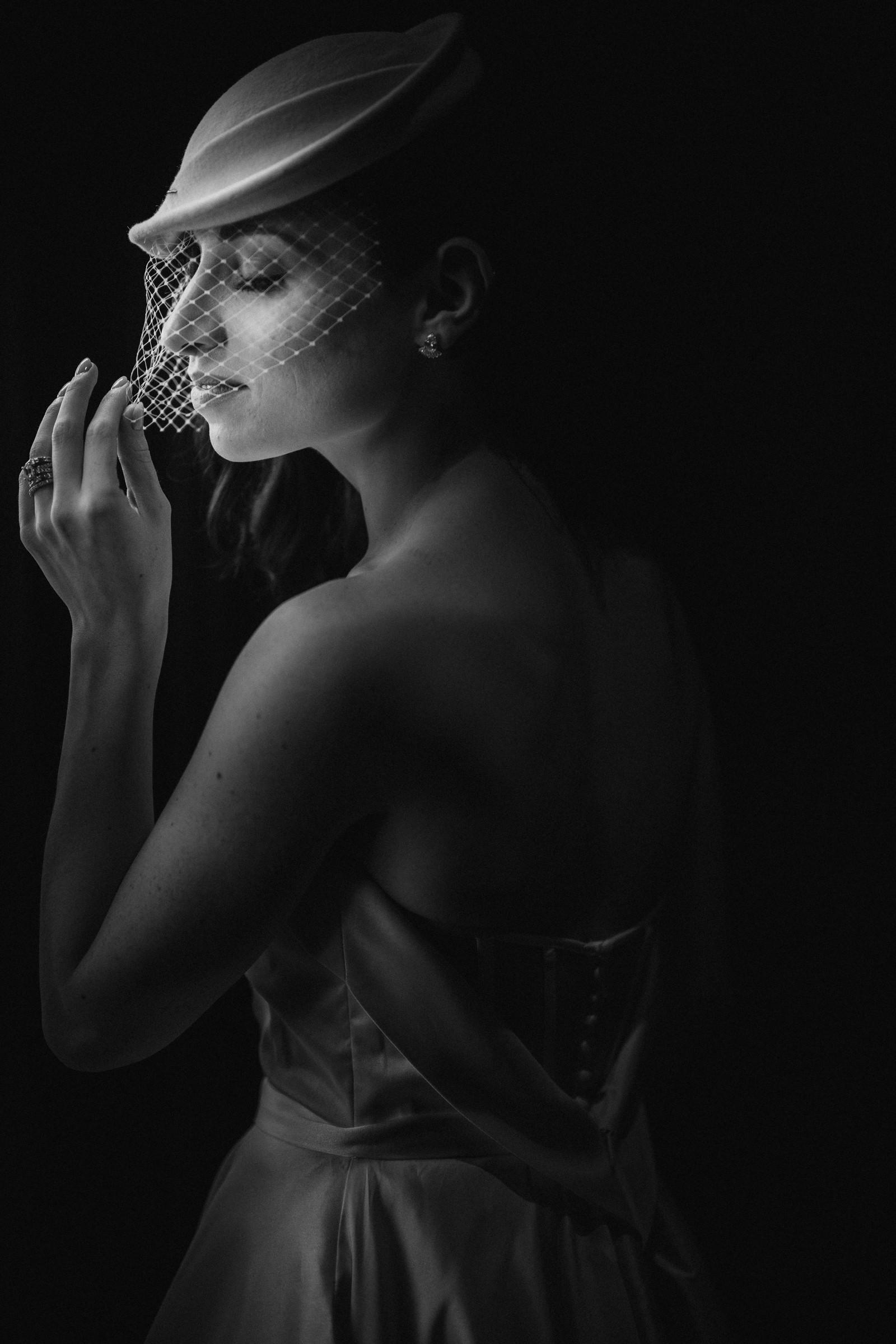 Profile of bride wearing modern birdcage veil - photo by Susan Stripling - New York