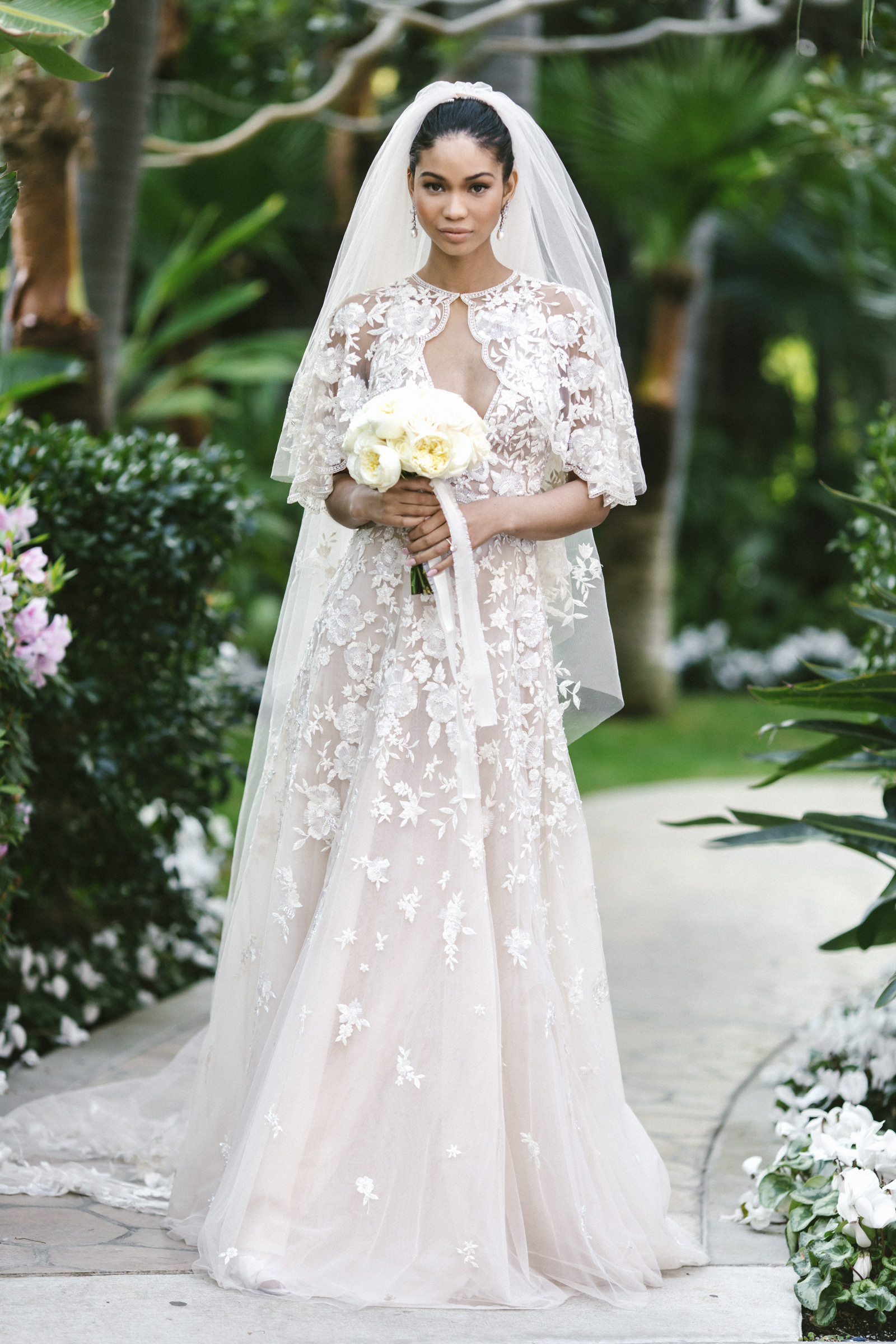 Elegant black bride in lace gown and veil by Amy and Stuart of Los Angeles