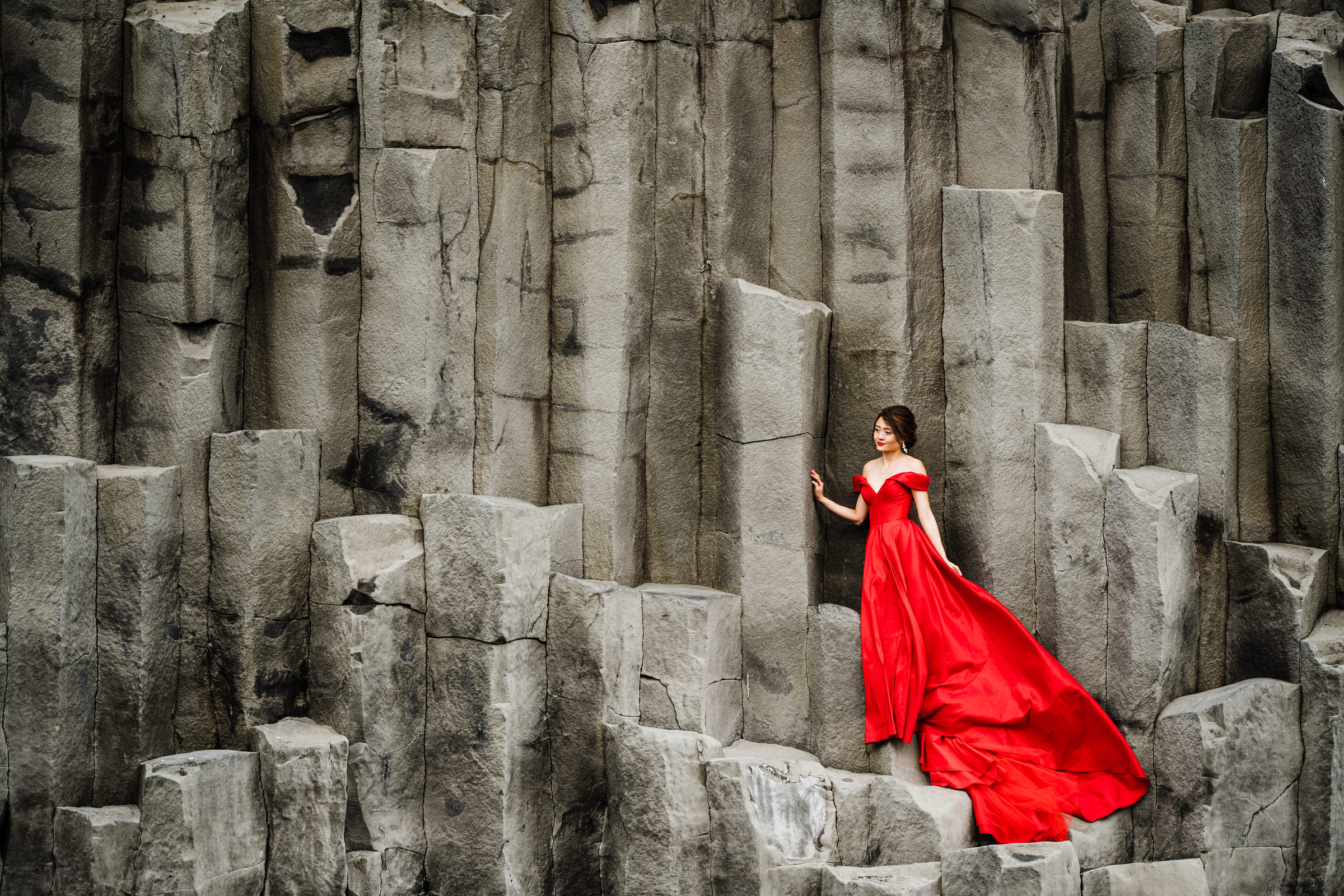 Bride on Basalt Columns in Vik, Iceland - Photo by M&J Studios