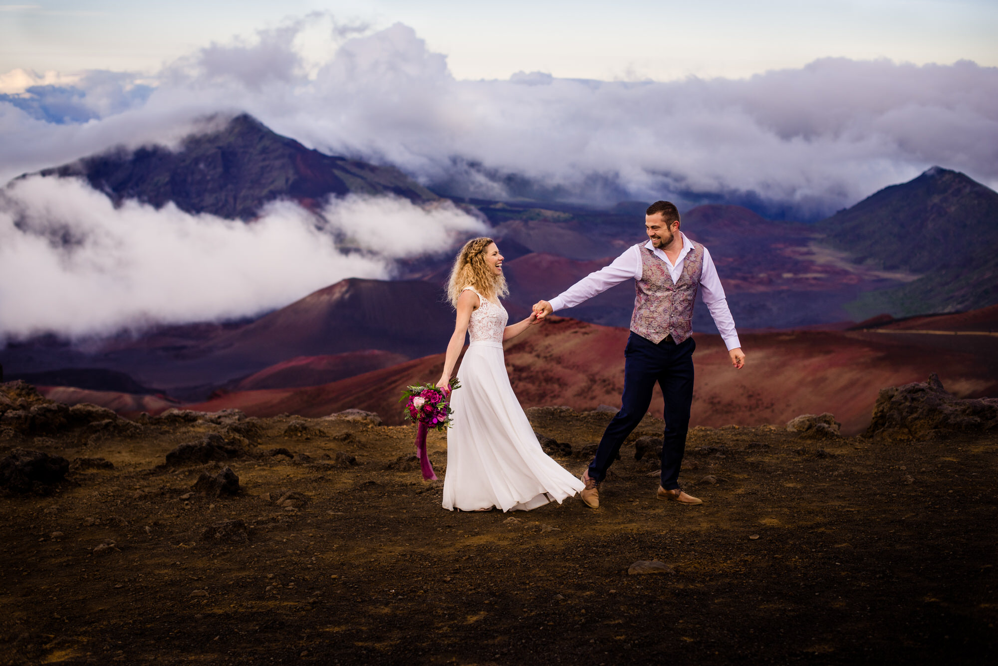 Laughing couple at the rim of Haleakala Crater, Maui - photo by Angela Nelson