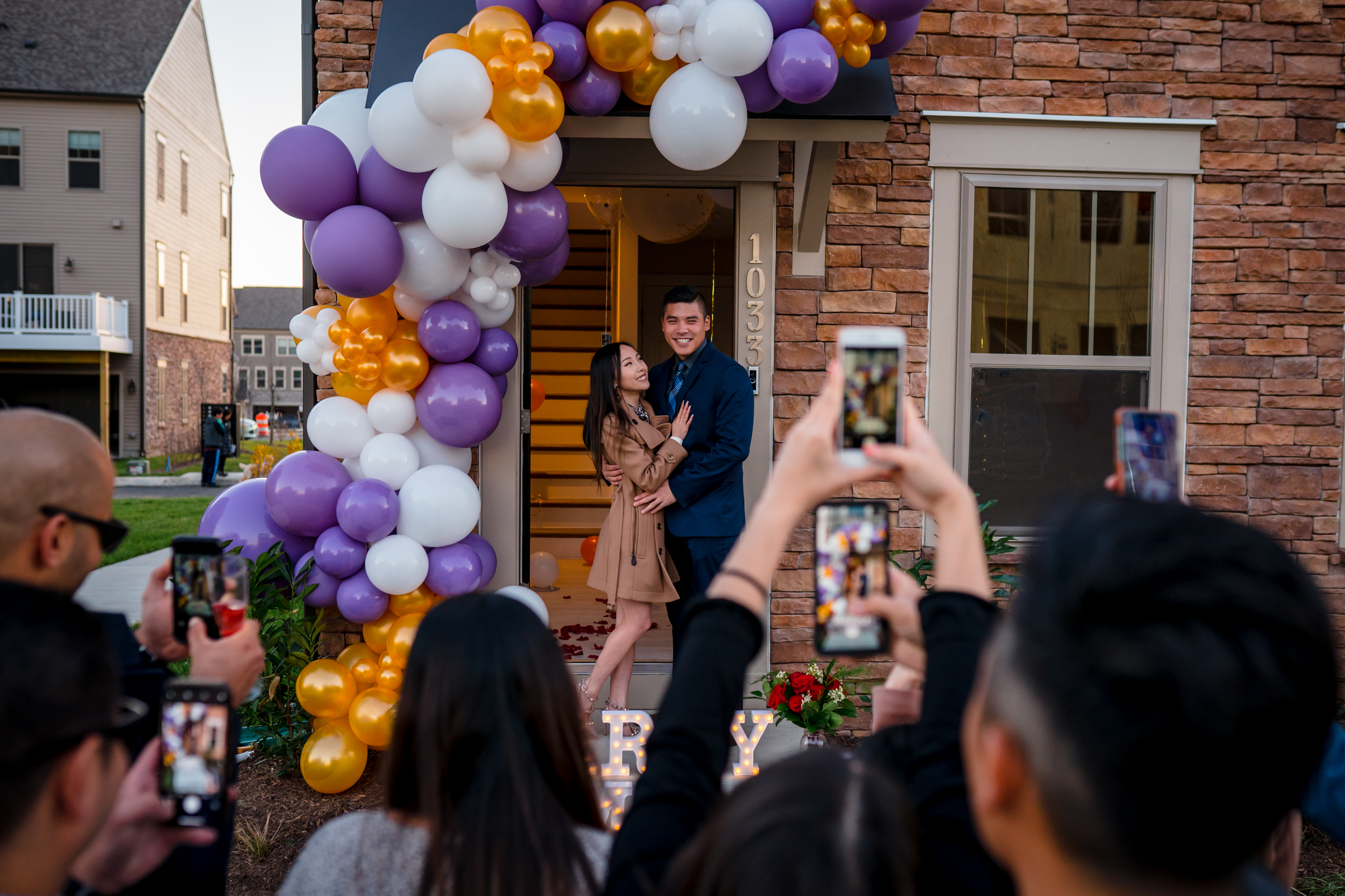 engagement-couple-with-balloons-and-well-wishers-taking-photos