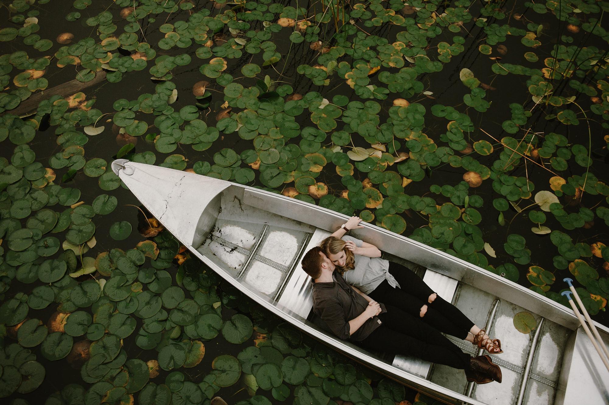 Couple lying in canoe - photo by Kristen Marie Parker