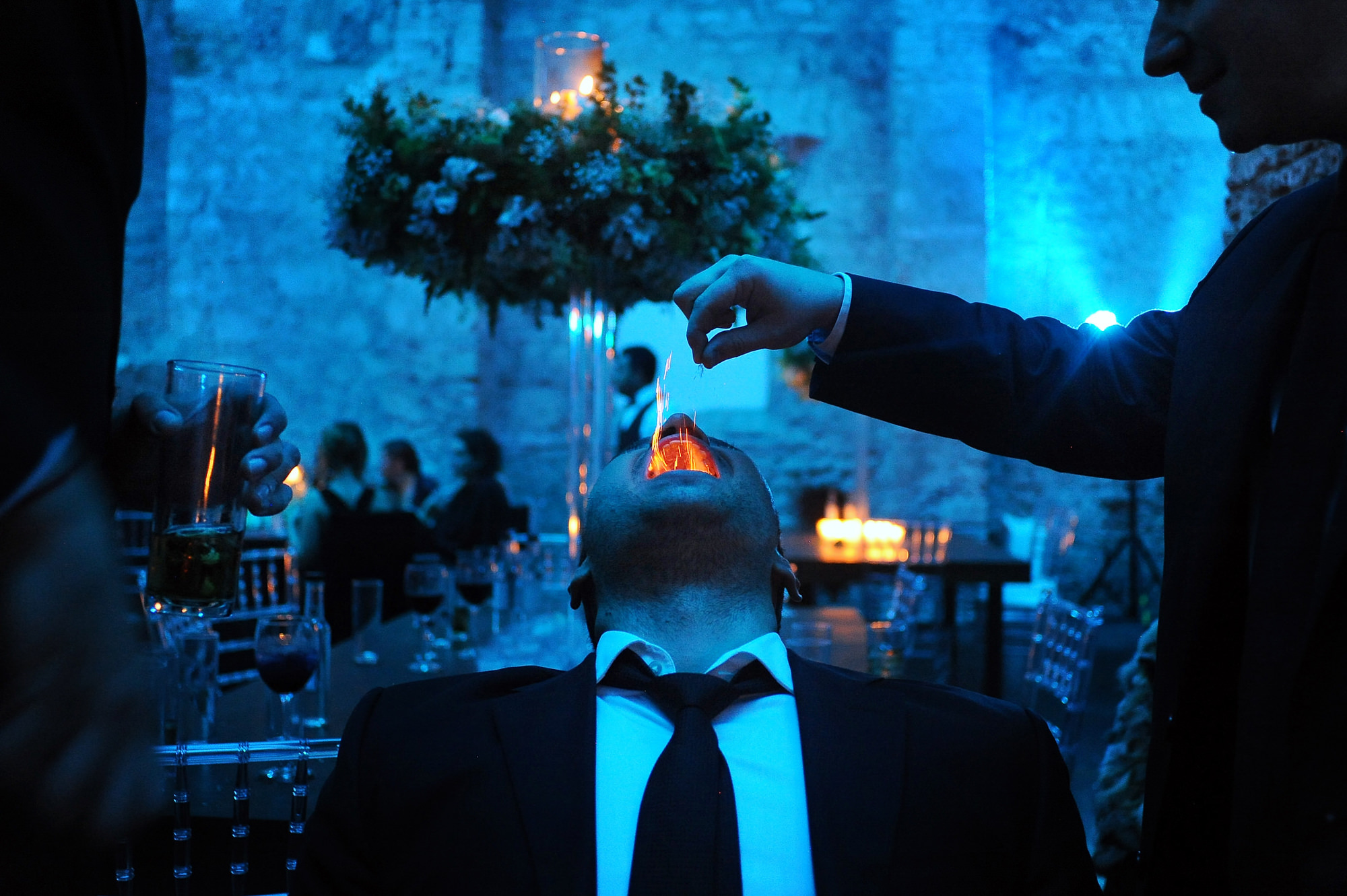 Groom performs ceremony with lit flame in his mouth - photo by Daniel Aguilar - Houston Texas