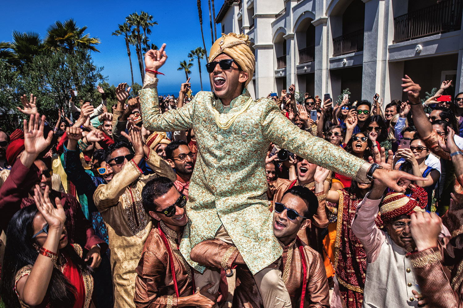 Happy Indian groom crowd surfing by Callaway Gable - Los Angeles
