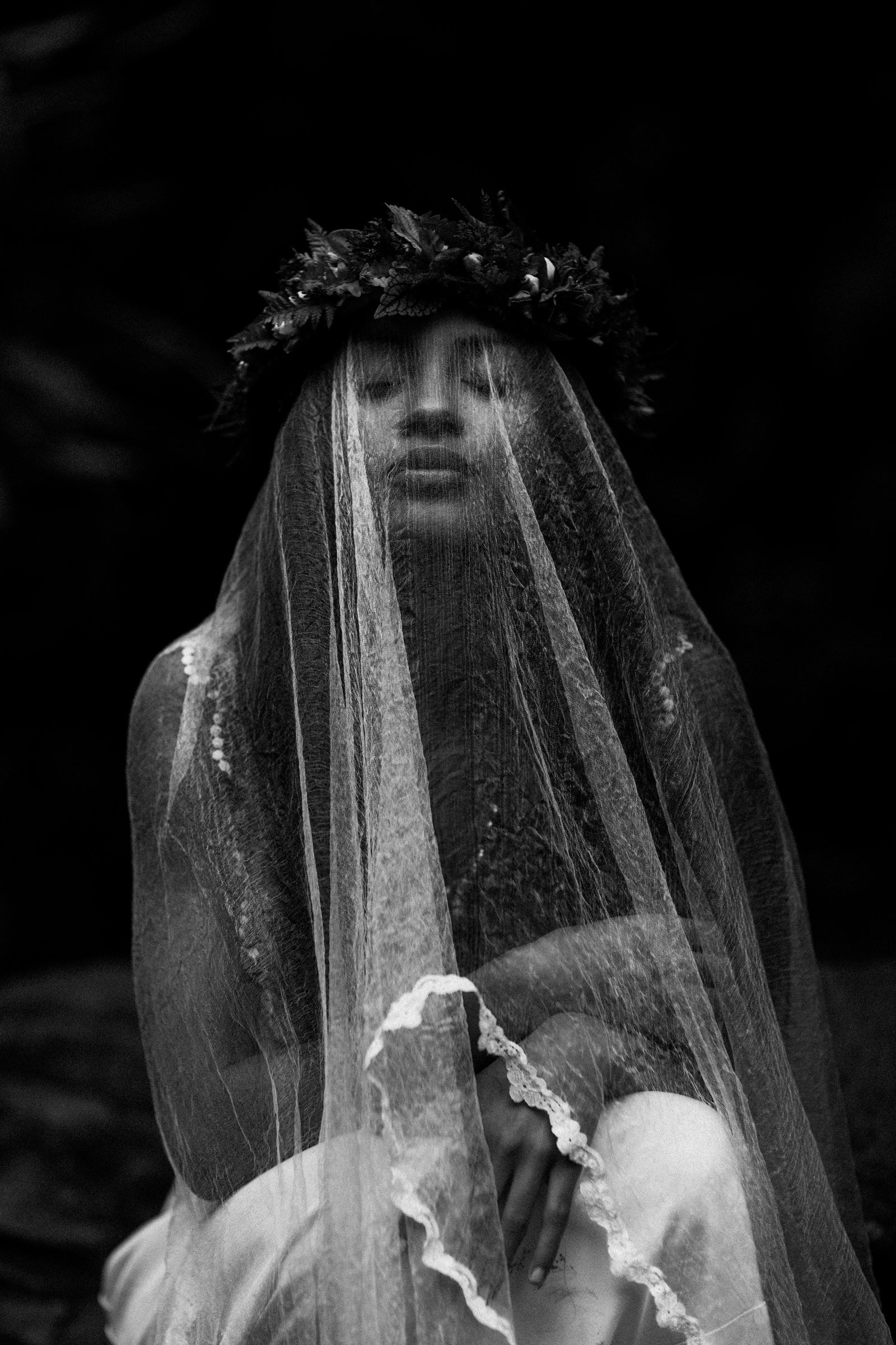 Ethereal black and white photo of Hawaiian bride under veil by Melia Lucida Photography