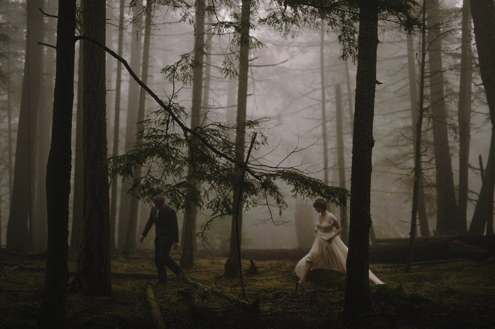 Ethereal photo of newly married couple walking in NW forest by Kristen Marie Parker