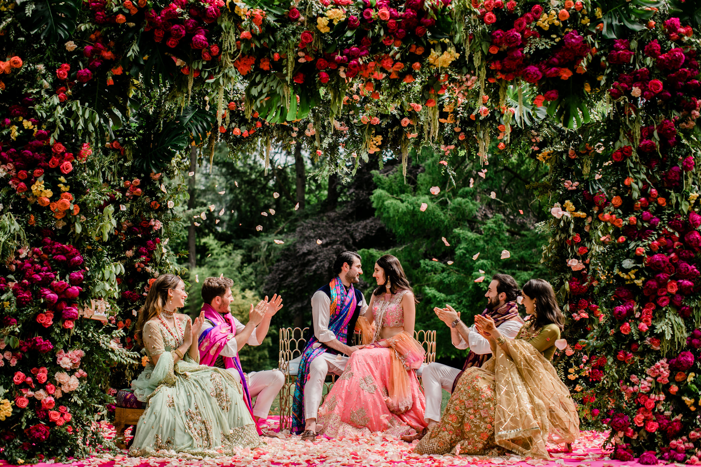 Elaborate floral arbor with red, purple, and pink roses photographed by Into Dust Photography - Seattle