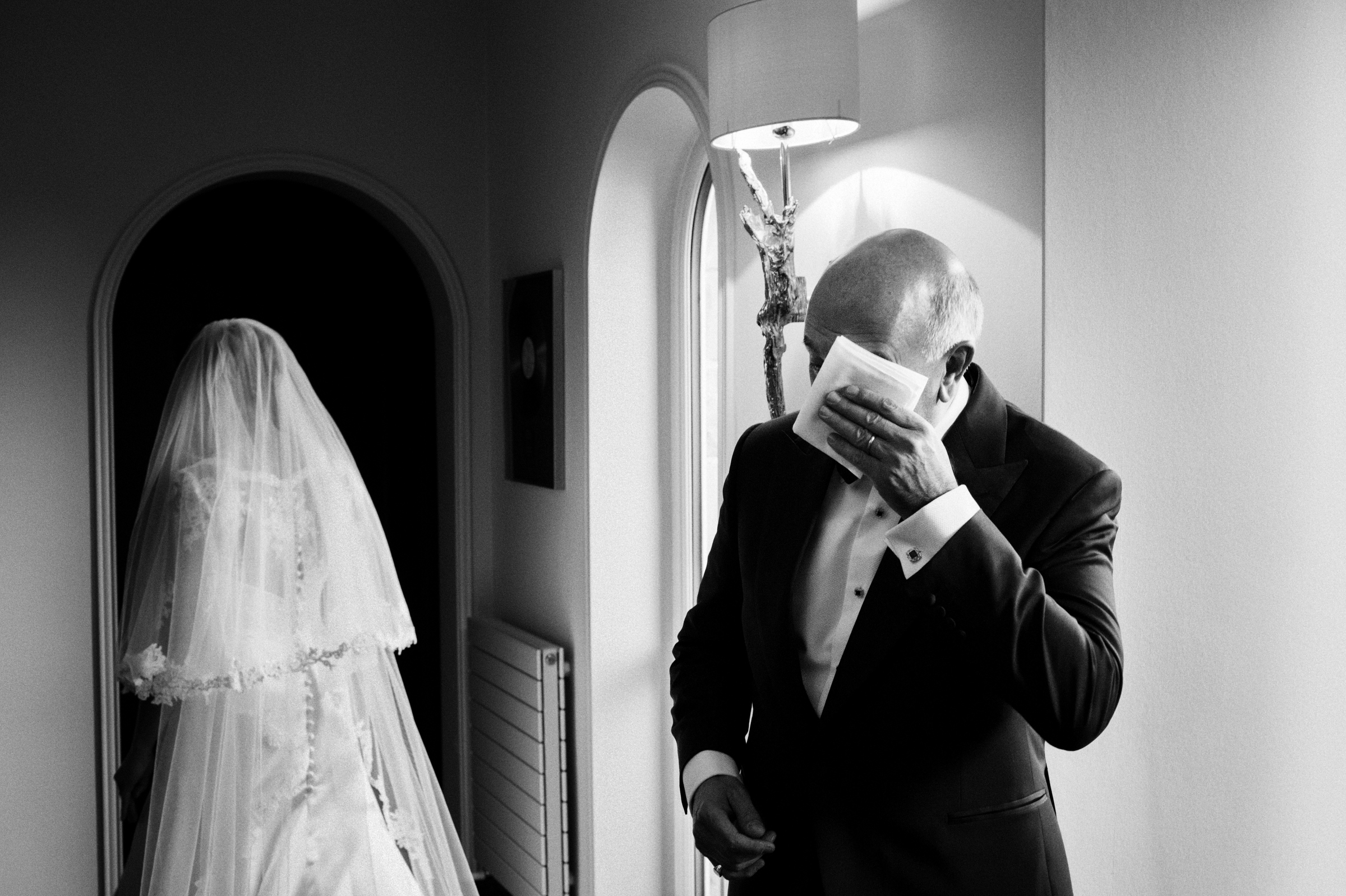 Father wipes his tears away as bride leaves for wedding ceremony - photo by Jeff Ascough,