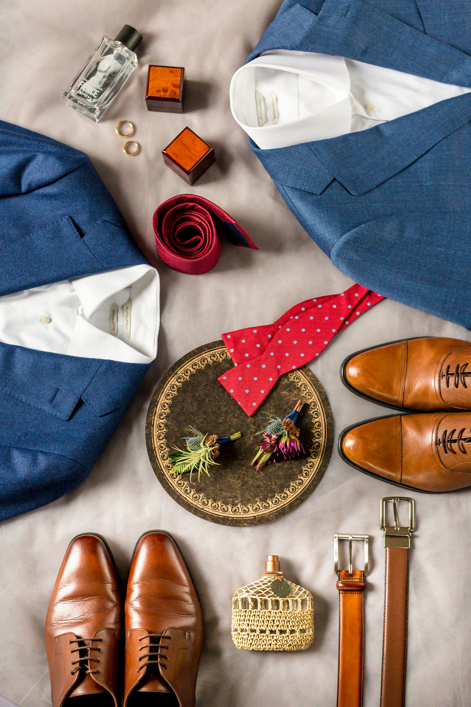 Flatlay of grooms accessories and thistle boutonnieres - Photo by Procopio Photography