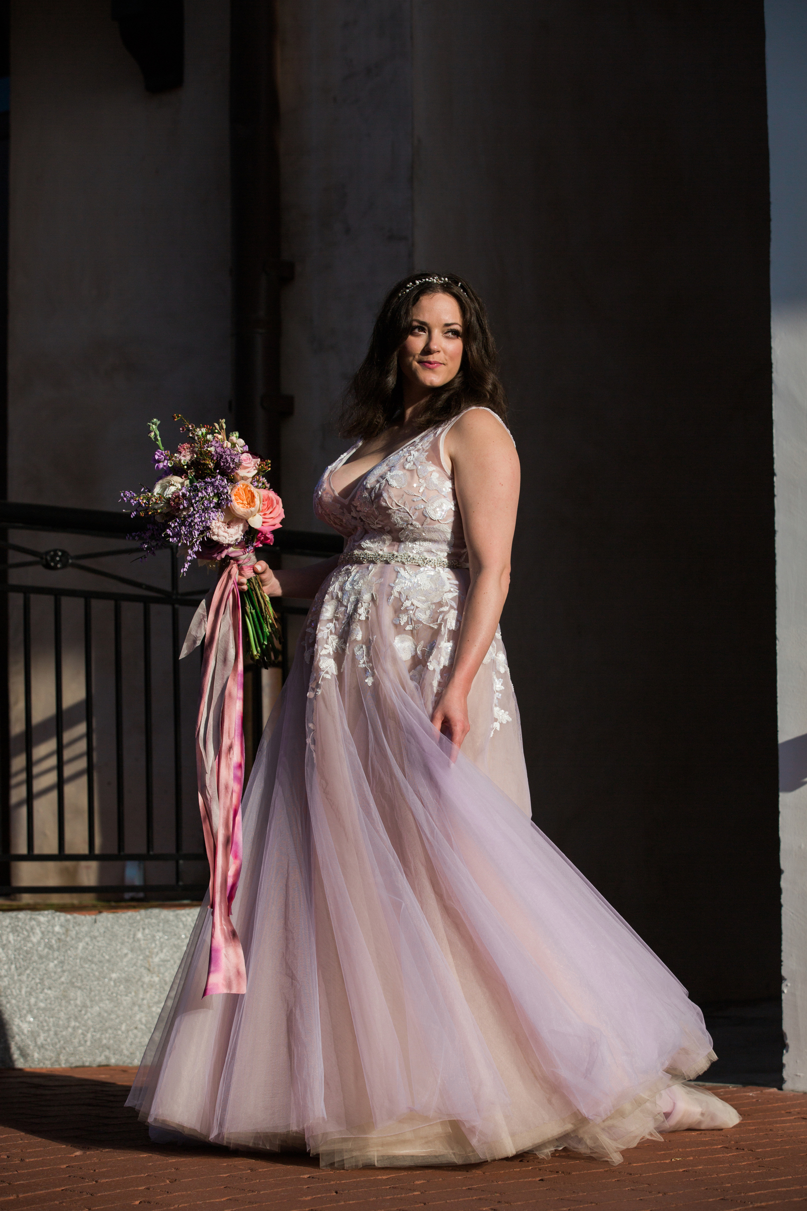 Bride wearing pink wedding dress with tulle skirt and lace applique bodice - photo by Modern Made
