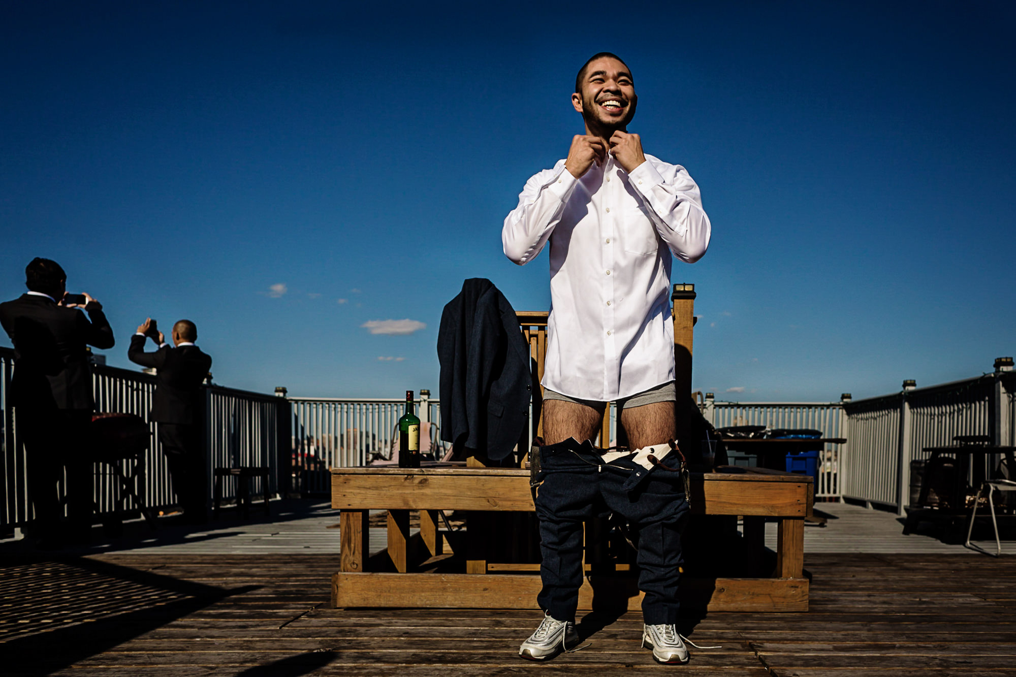 funny-groom-in-stages-of-dress-at-rooftop-worlds-best-wedding-photos-jag-studios-connecticut-wedding-photographers