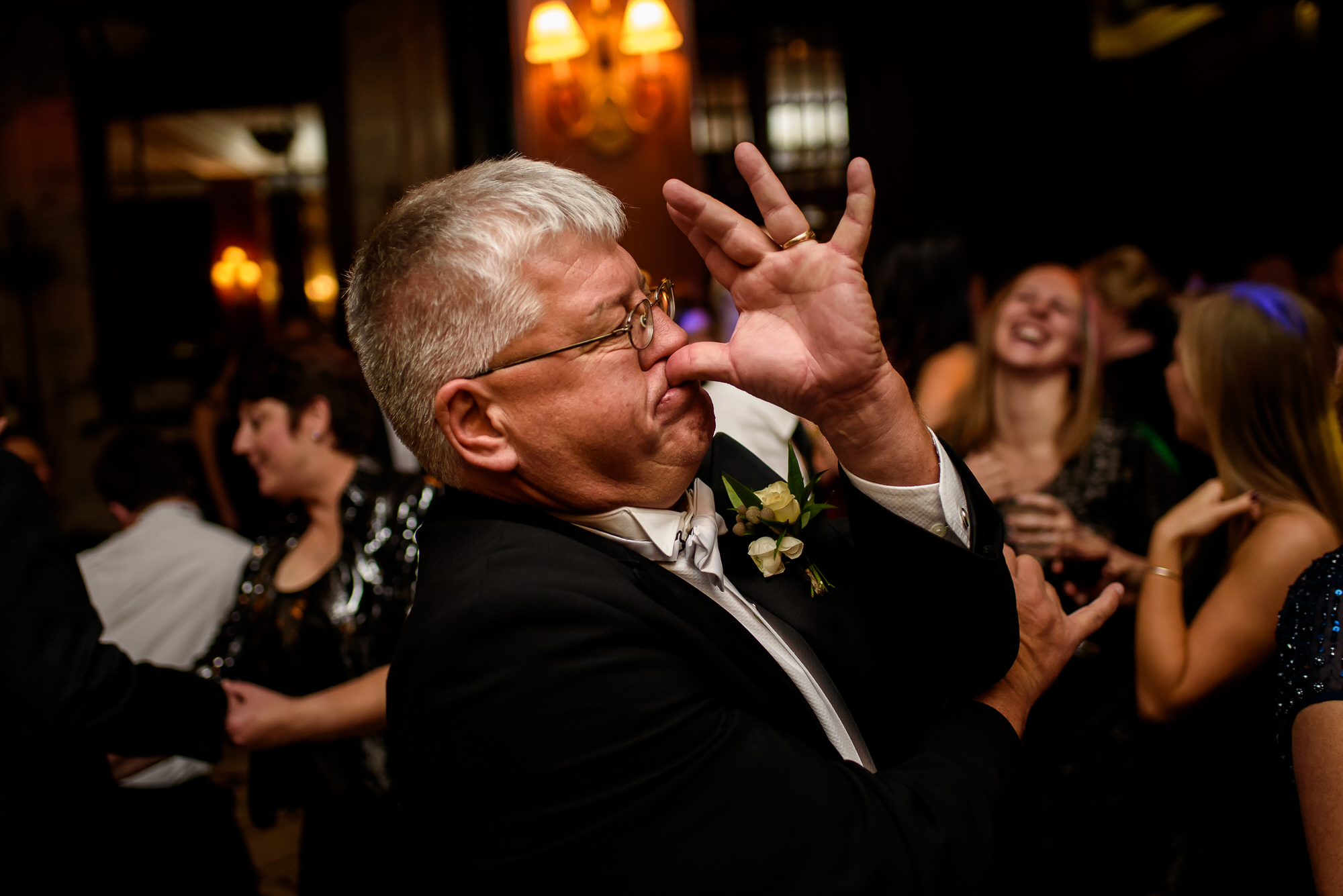 funny-photo-of-guest-trumpeting-with-hand-worlds-best-wedding-photos-tyler-wirken-kansas-city-wedding-photographers