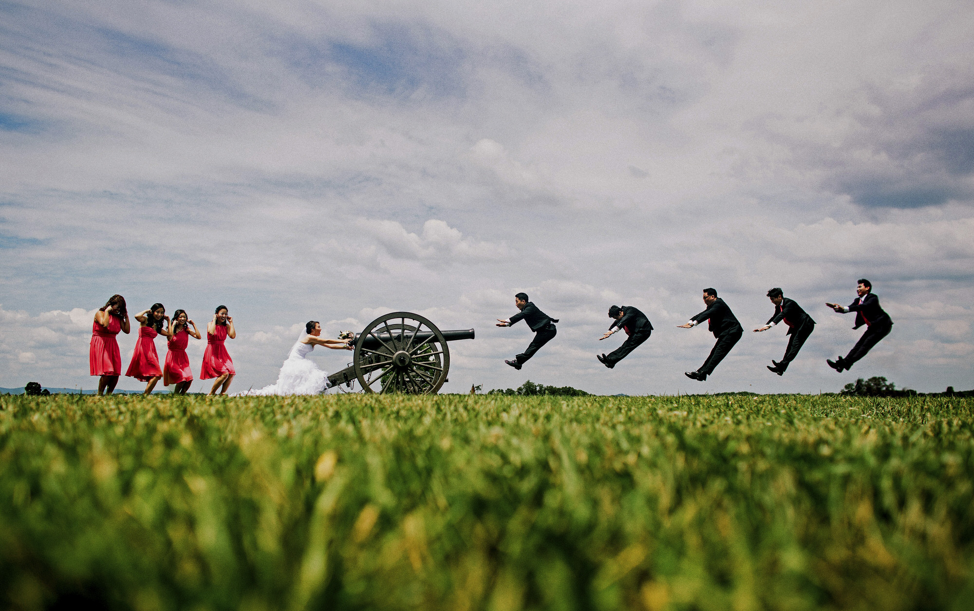 Funny portrait of groomsmen being shot out of cannon - photo by Ken Pak