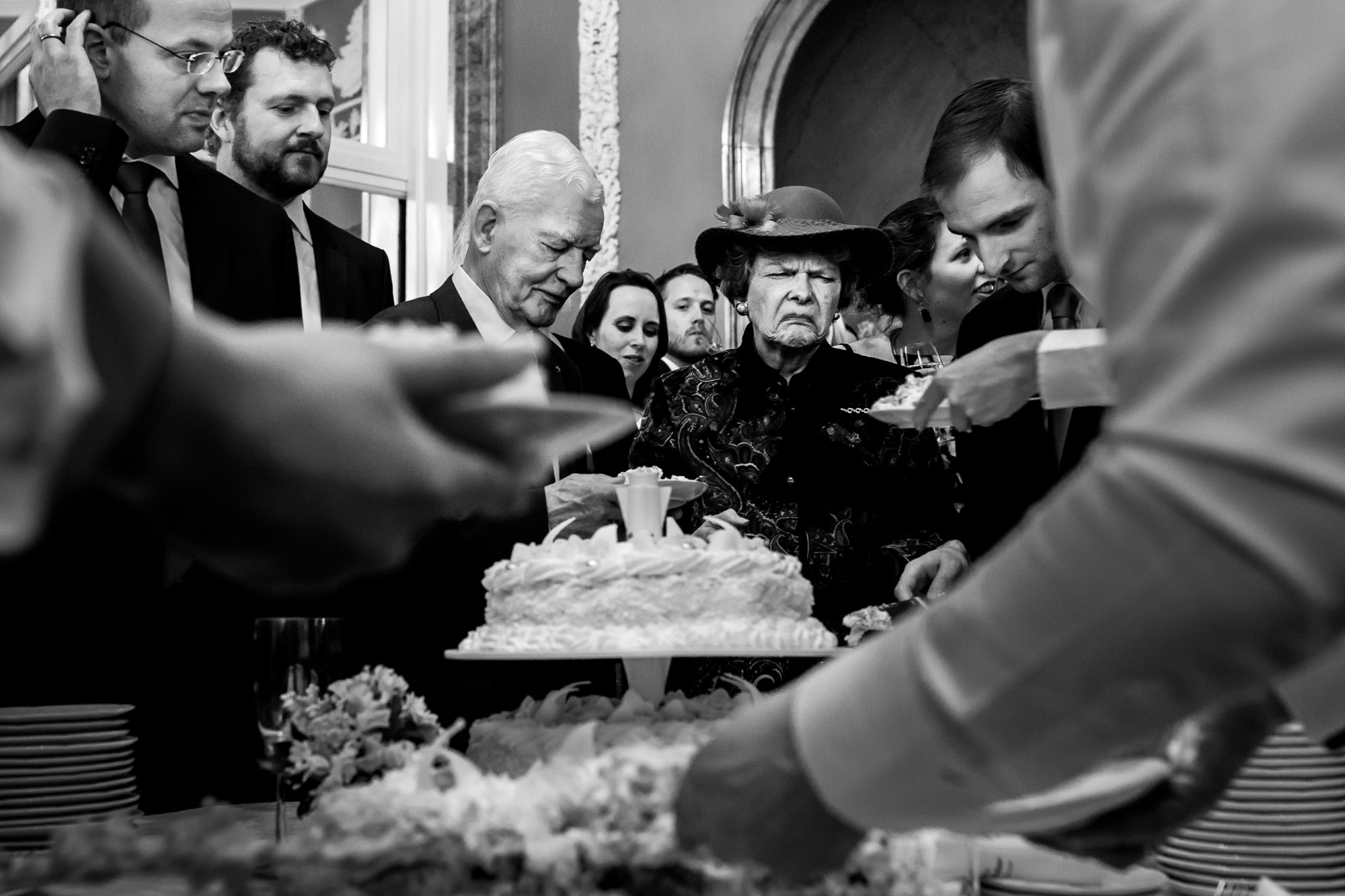 Guest turns her nose up at wedding cake - photo by Fotobelle