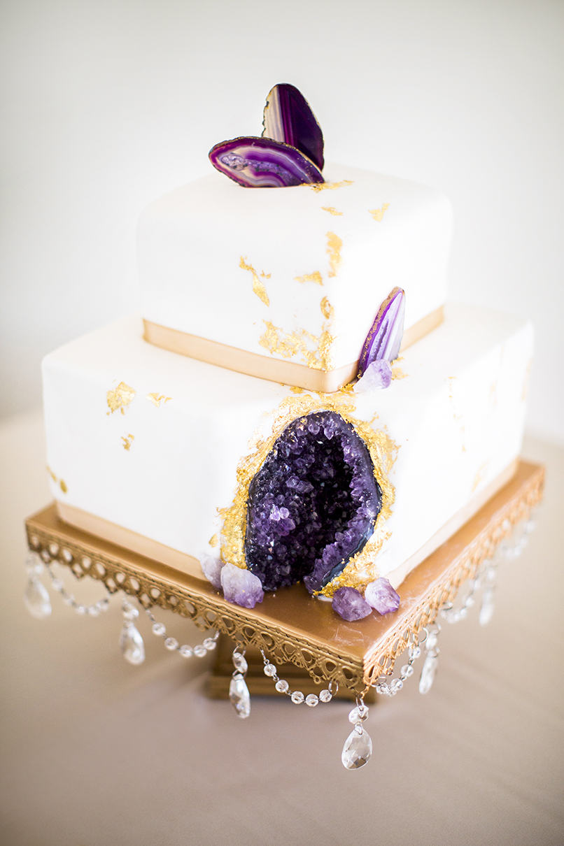 Wedding cake with purple amethyst geode inside photographed by Anna Schmidt