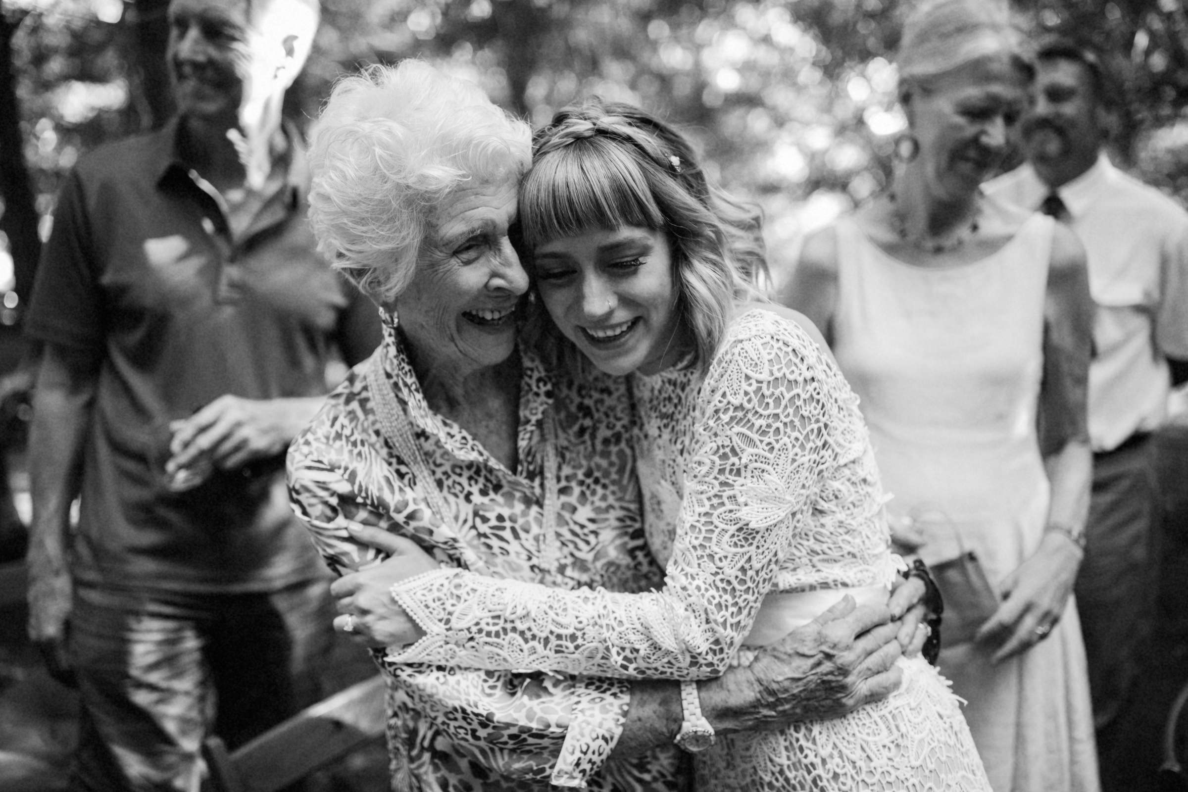 Grandmother and bride embrace at reception - photo by Jonas Seaman - Seattle