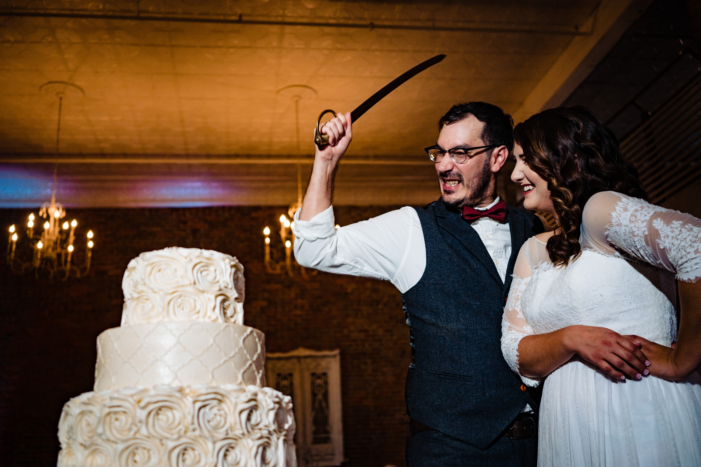 Groom goes after wedding cake with a sabre - Vinson Images - Arkansas