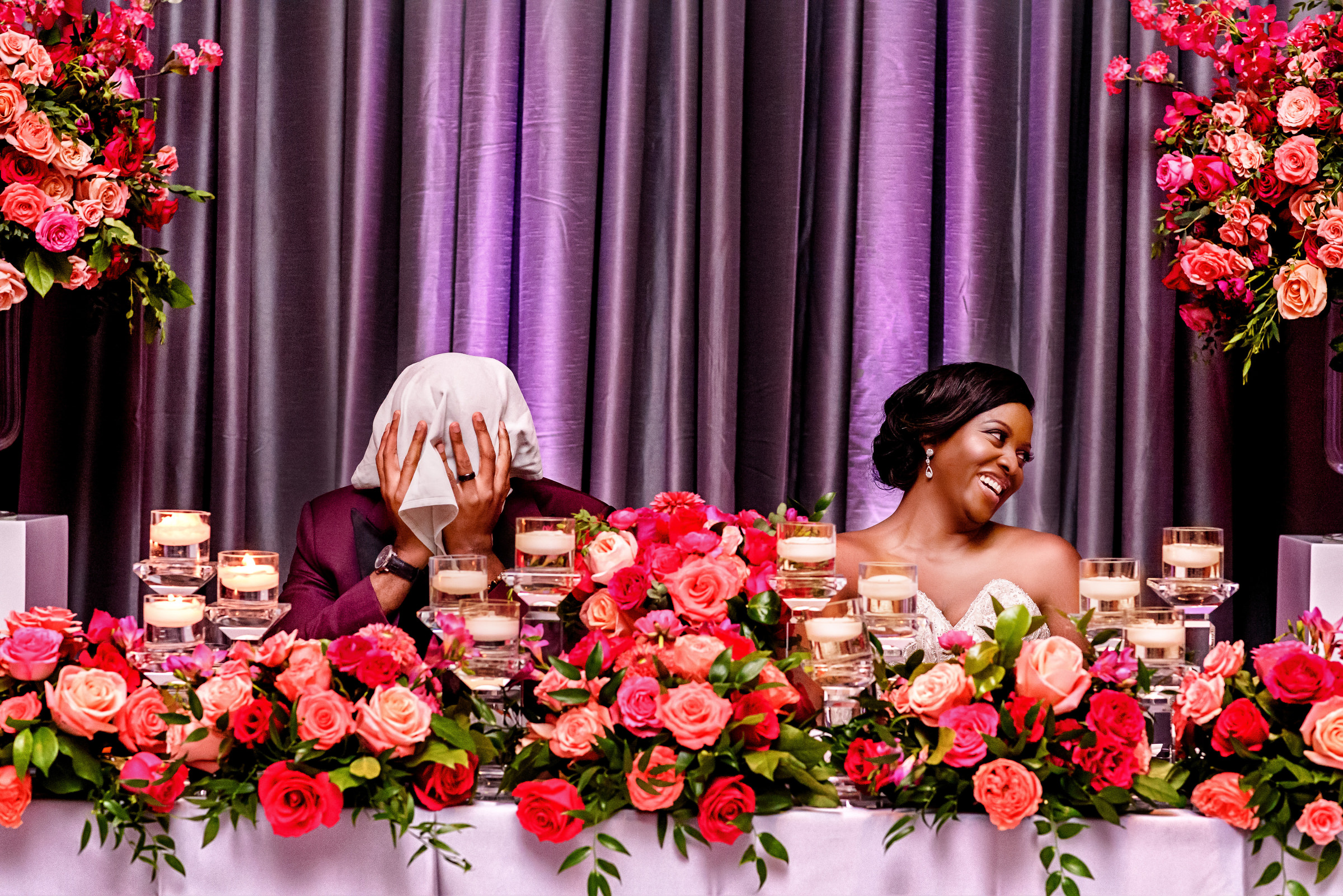 Hilarous photo of bride laughing and groom hiding during toast by Kirth Bobb - D.C. photographer