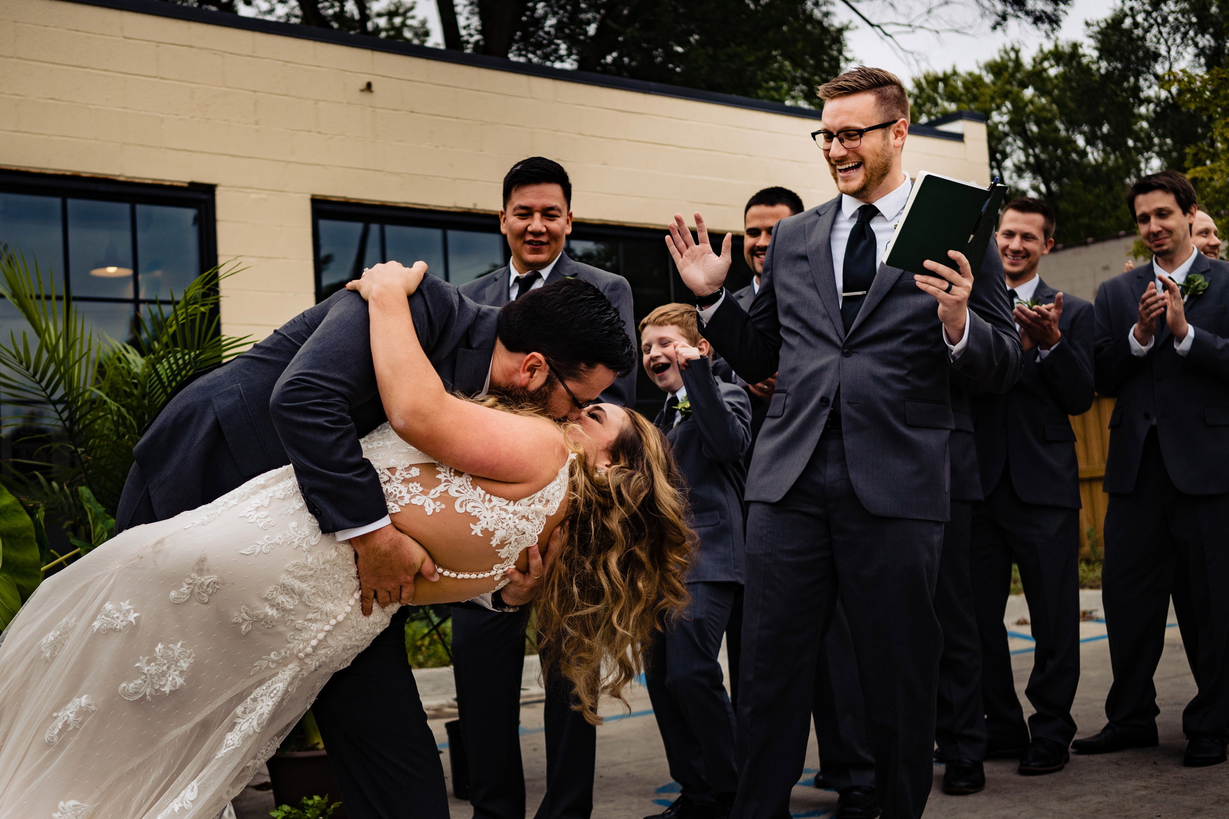 Groom dipping bride and almost dropping her - Vinson Image, Arkansas wedding photographer