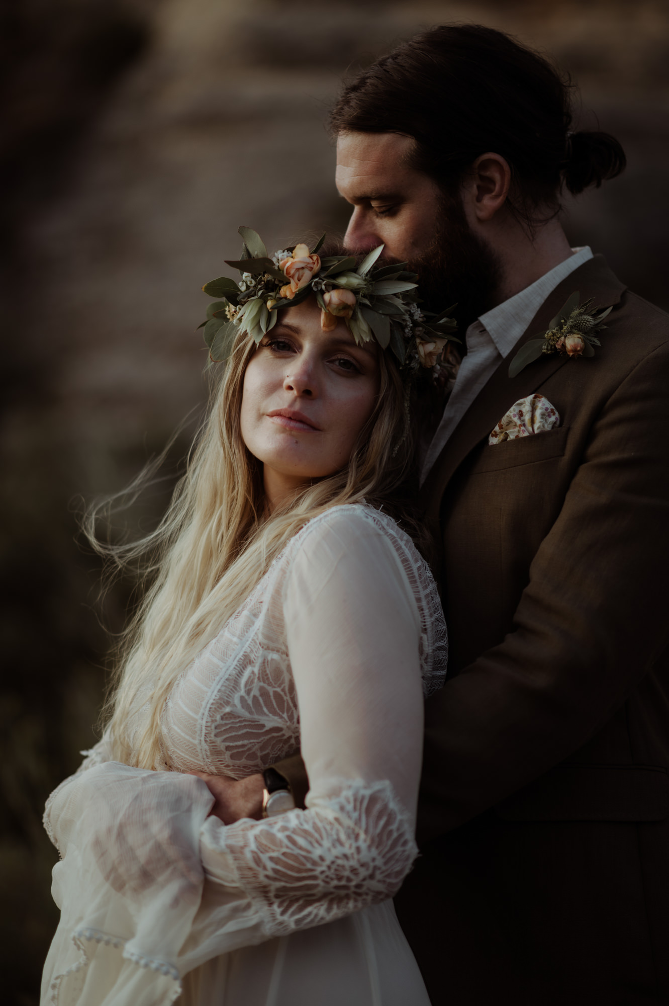 Groom holds bride with bay leaf and apricot rose crown - photographed by The Kitcheners - Scotland