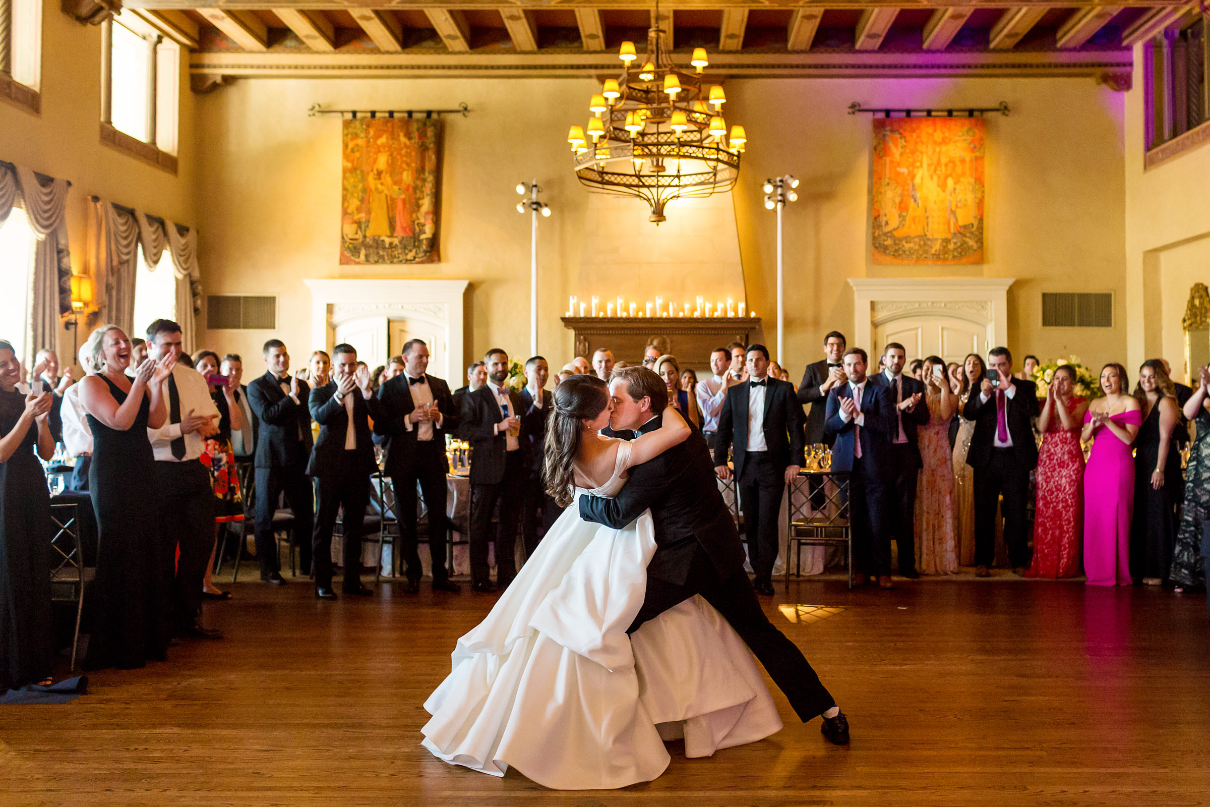 groom-kisses-and-dips-bride-at-first-dance-procopio-photography