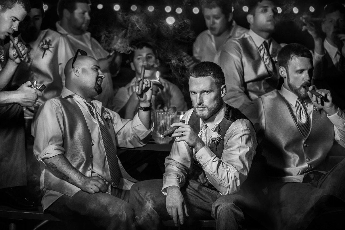 groom-raises-a-glass-surrounded-by-his-guys-photo-by-amber-henry-photography-michigan
