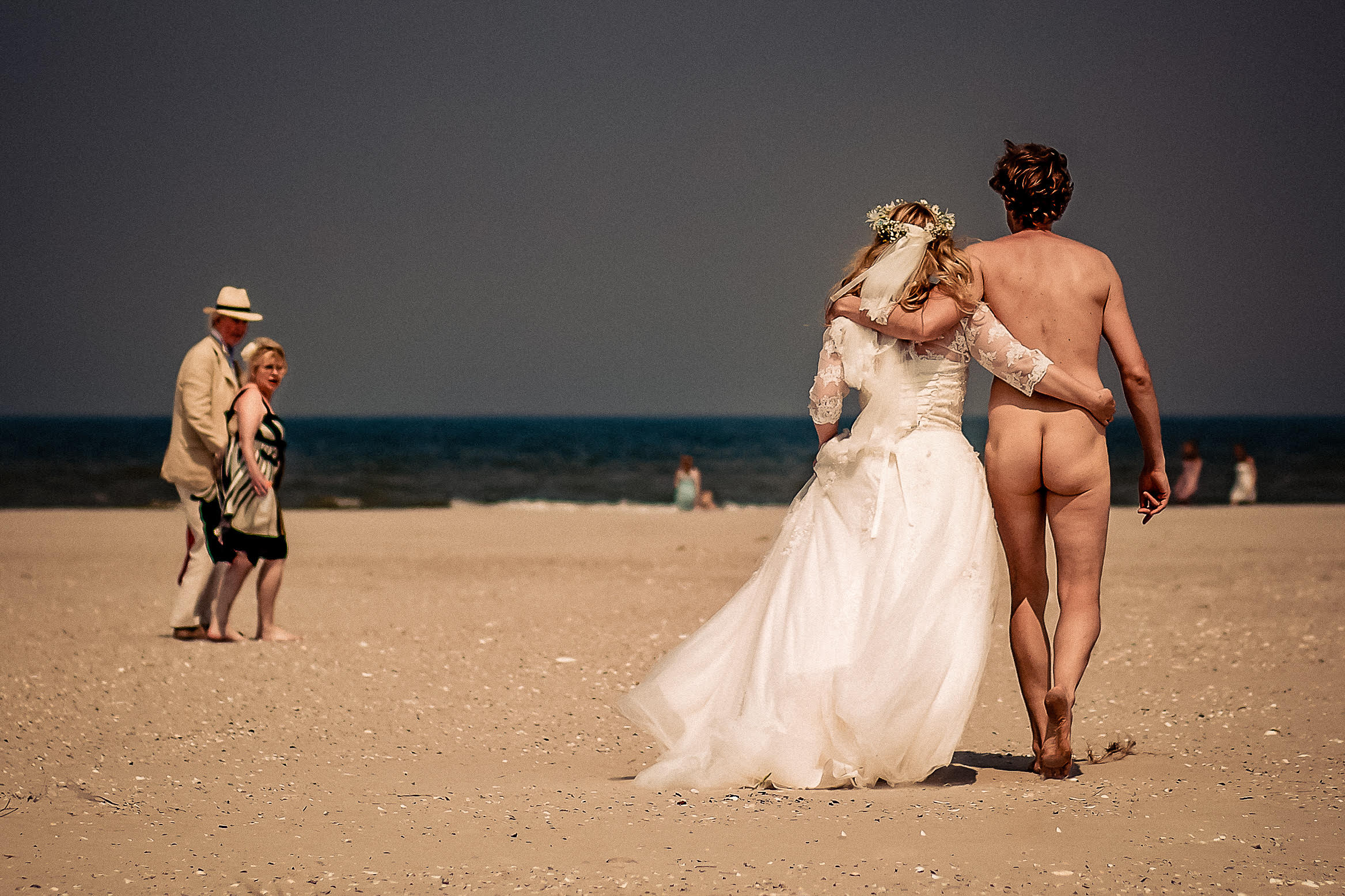 groom-wearing-his-birthday-suit-with-bride-on-beach-eppel-photography