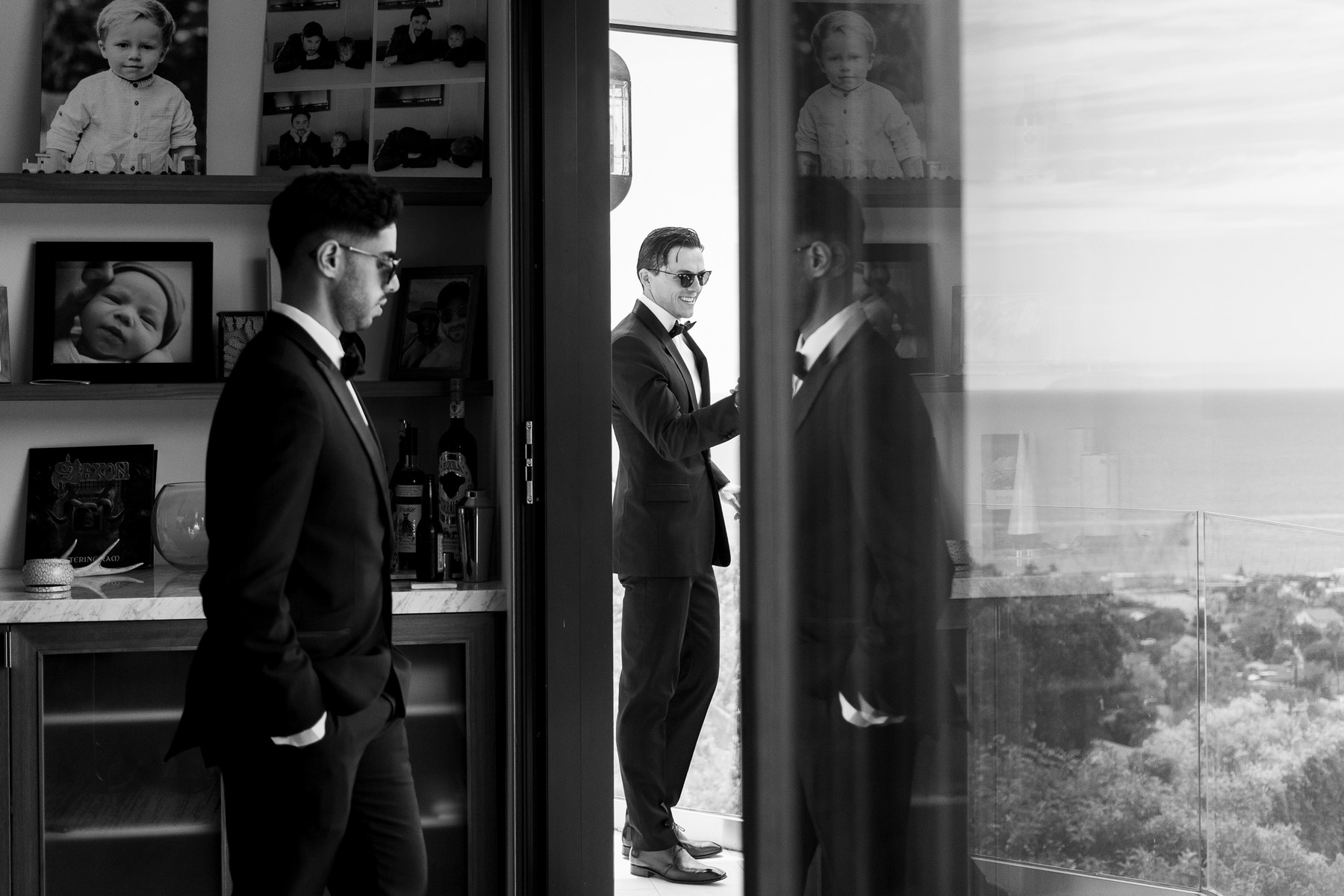 Groomsmen getting ready in tuxes by John and Joseph of Los Angeles