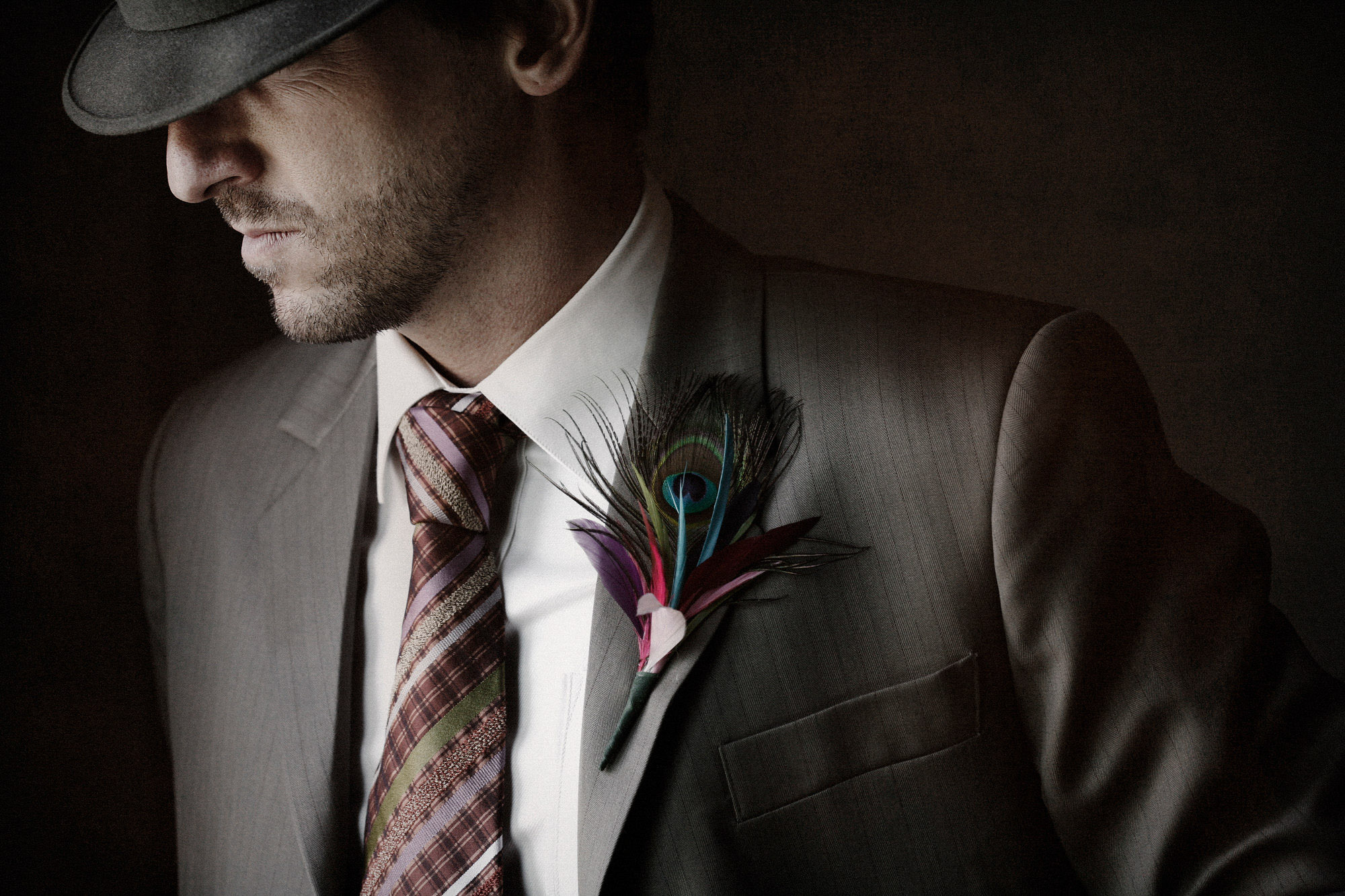 Peacock feather boutonniere - photo by Jerry Ghionis - Las Vegas wedding photographer