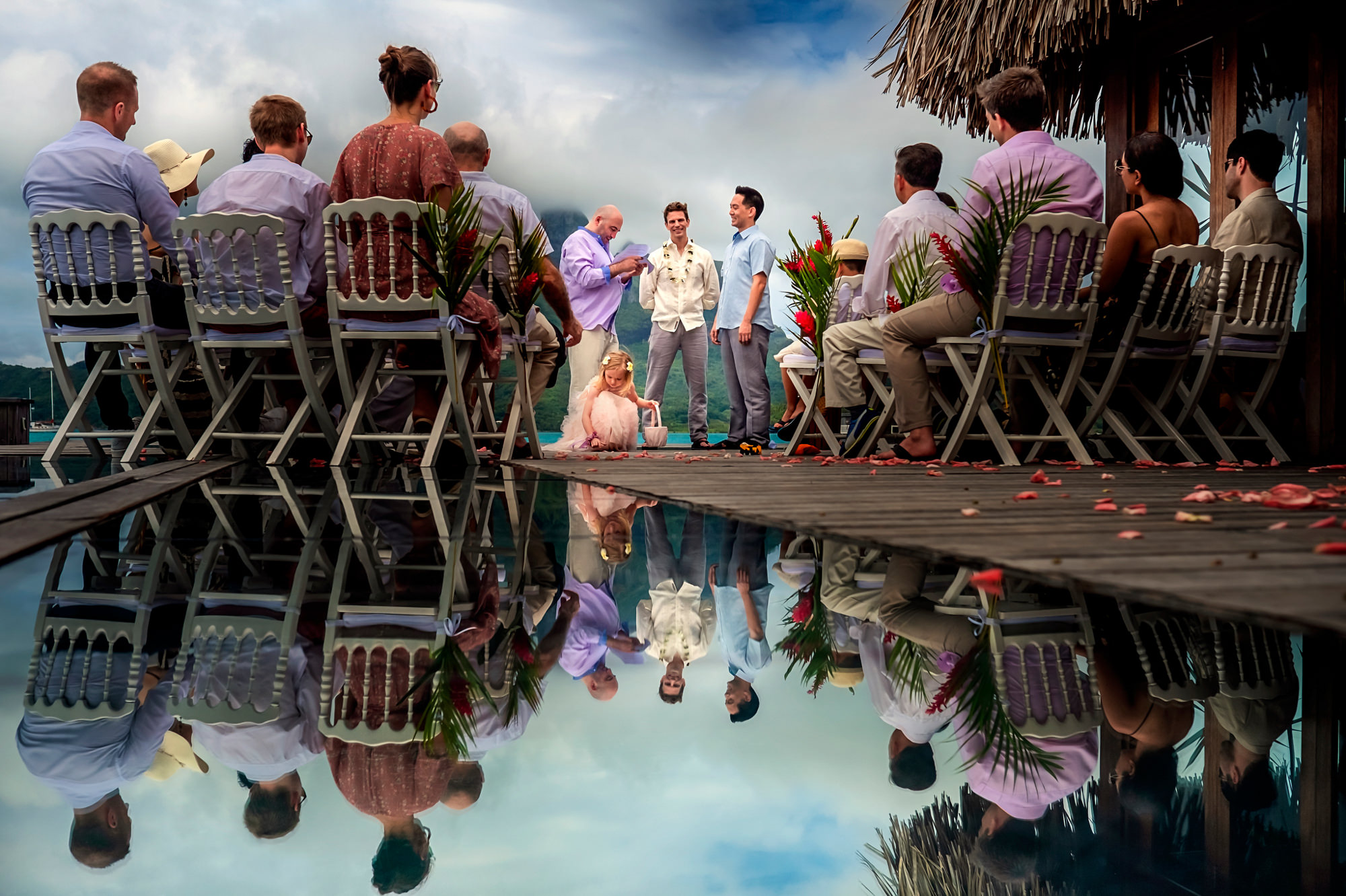 Waterfront wedding with pool reflection - photo by Chrisman Studios