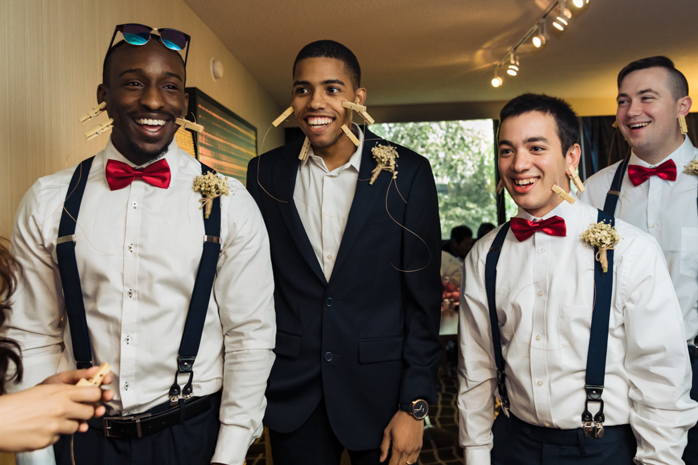 groomsmen-smiling-with-clothespins-attached-yun-li-photography